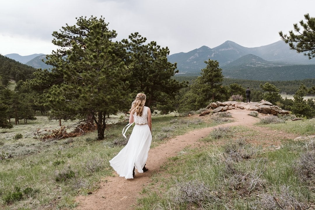 Bride walking down the trail for first look at 3M Curve in Rocky Mountain National Park, Colorado elopement photographer, first look in the mountains