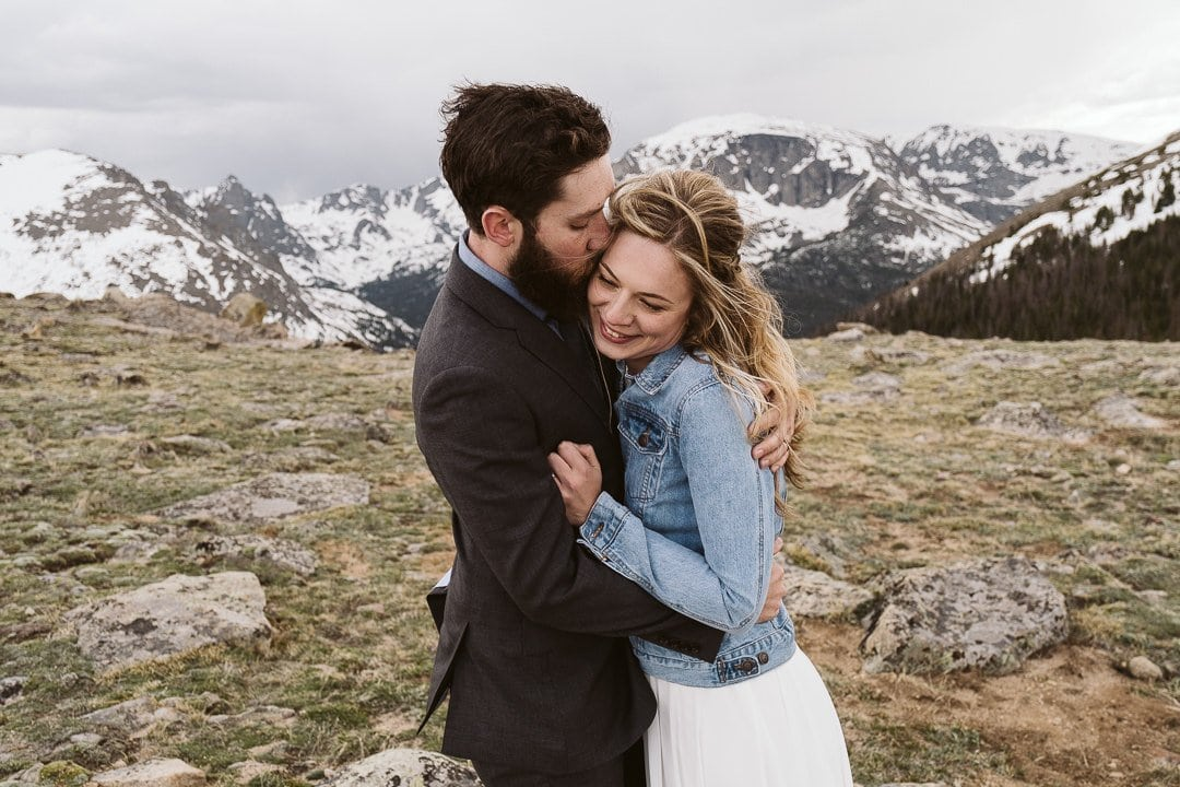 Bride and groom wedding photos at Trail Ridge Road, Rocky Mountain National Park elopement photographer, Colorado winter elopement