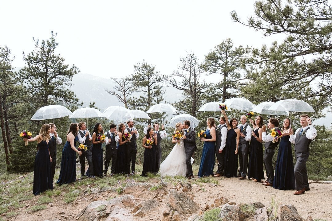 Wedding party photos with clear umbrellas on Flagstaff Mountain in Boulder, Sunrise Amphitheater wedding photography in Boulder Colorado