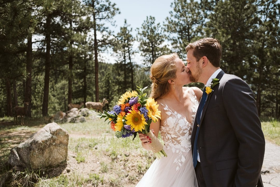 Bride and groom portraits at Flagstaff Mountain in Boulder after Sunrise Amphitheater wedding ceremony, Boulder wedding photographer, bride in BHLDN dress with sunflower bouquet