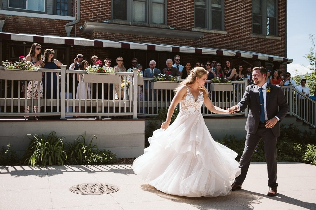 Bride and groom first dance outdoors in the sun at CU Koenig Alumni Center wedding, Boulder wedding photographer