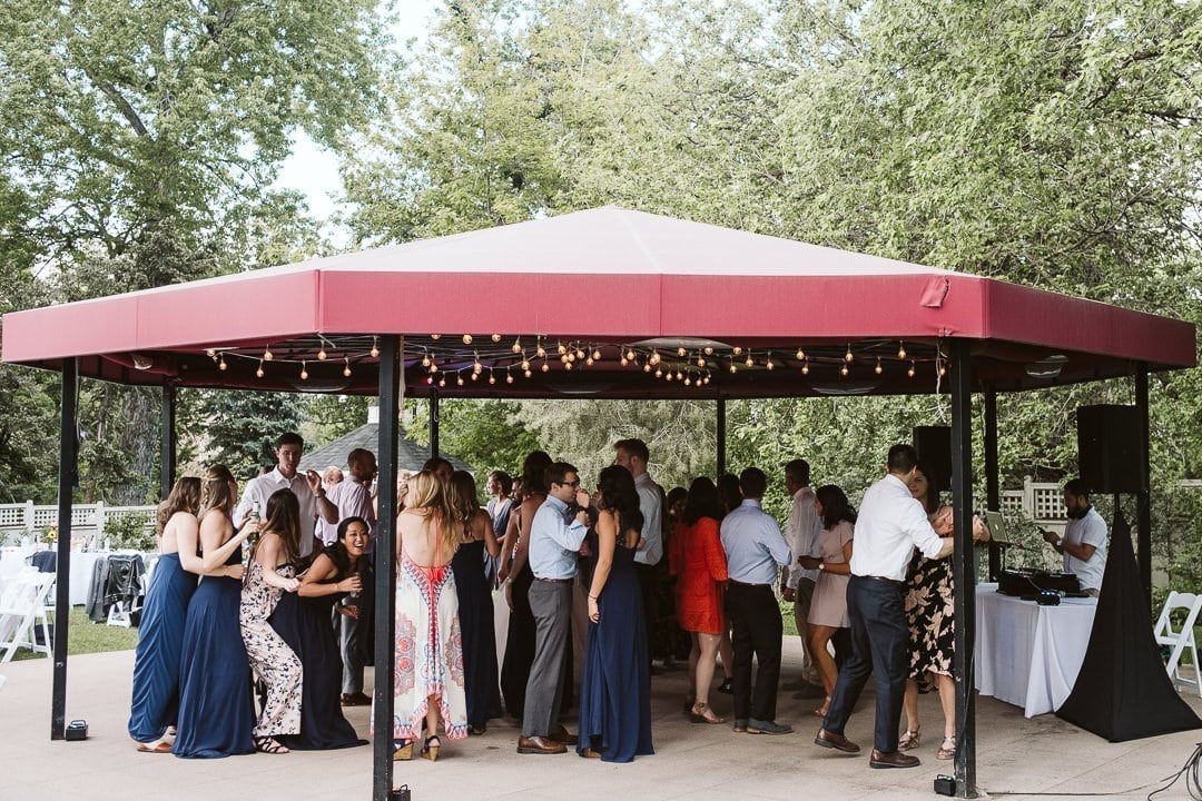 Outdoor dancing under string lights at CU Koenig Alumni Center wedding in Boulder