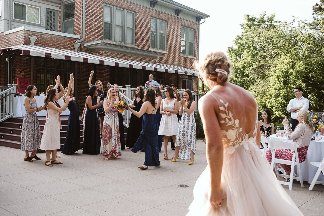 Bride bouquet toss at CU Koenig Alumni Center wedding in Boulder
