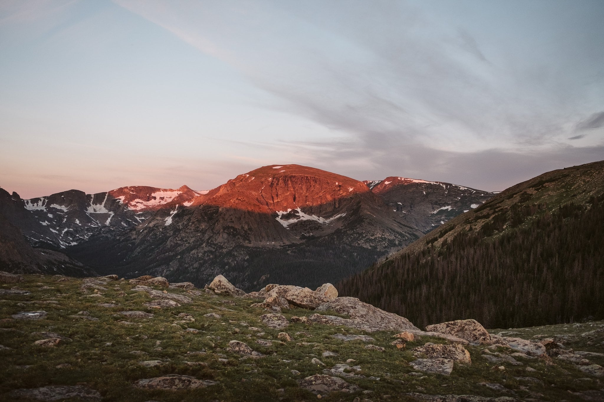 Sunrise alpenglow on the mountains in RMNP