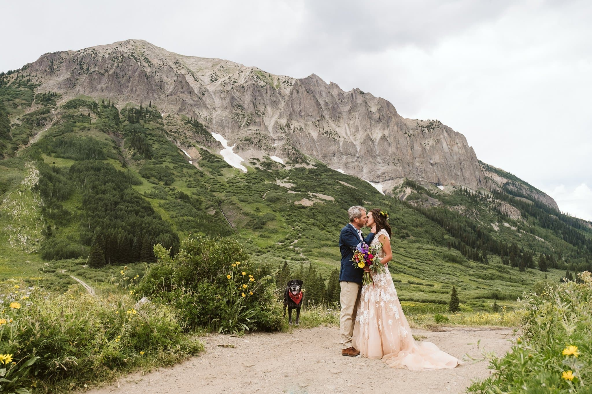 Crested Butte wedding in mountains with wildflowers, Colorado wedding photographer