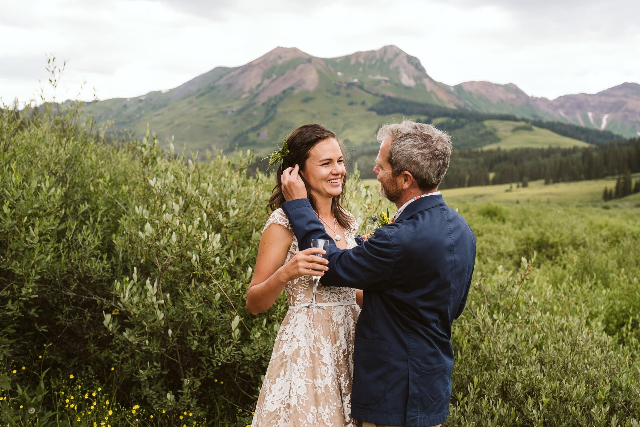 Bride and groom drinking champagne in the mountains, Crested Butte wedding photographer