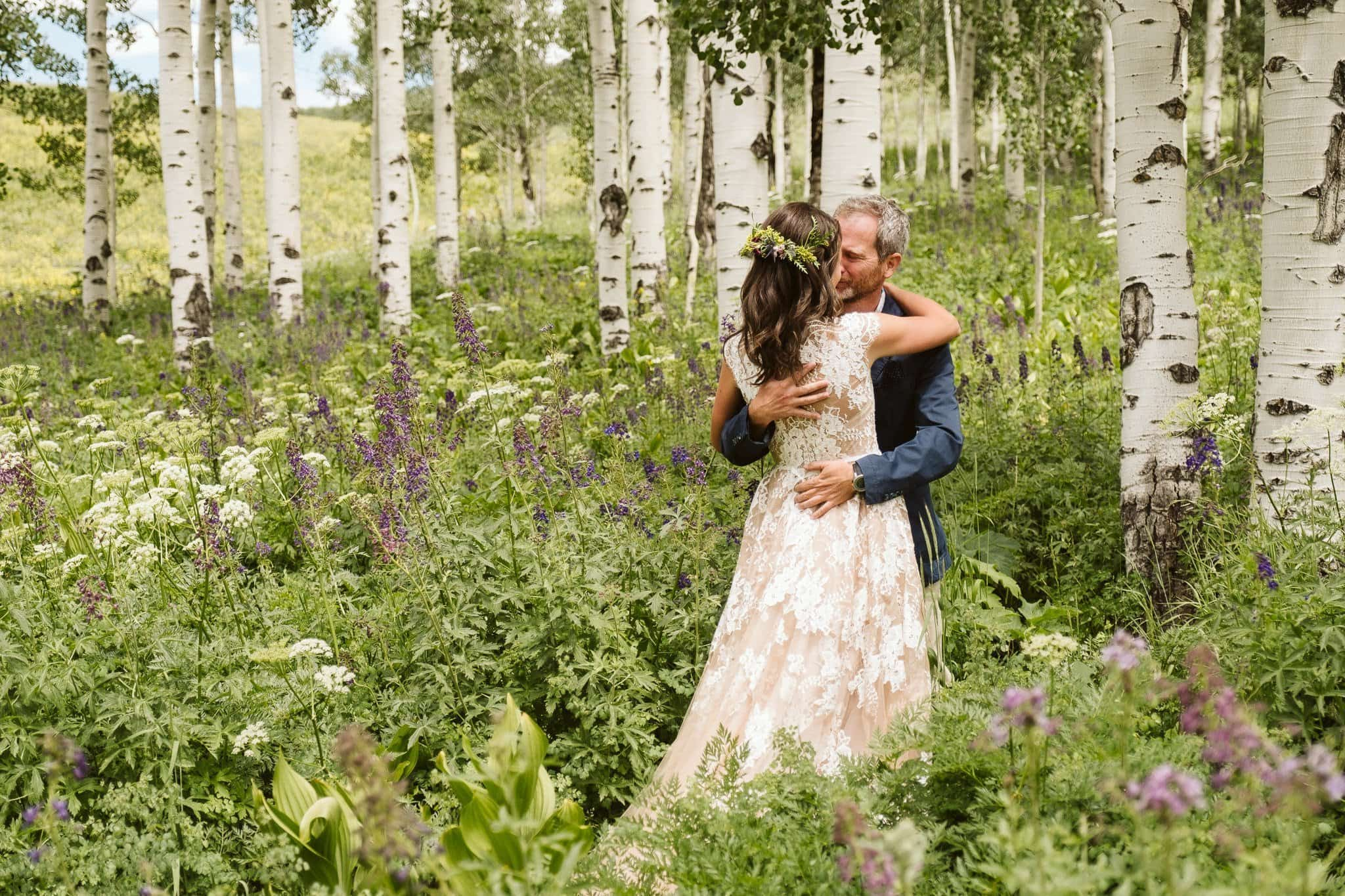 First look in Crested Butte aspen grove with wildflowers, Crested Butte wedding, Colorado wedding photographer