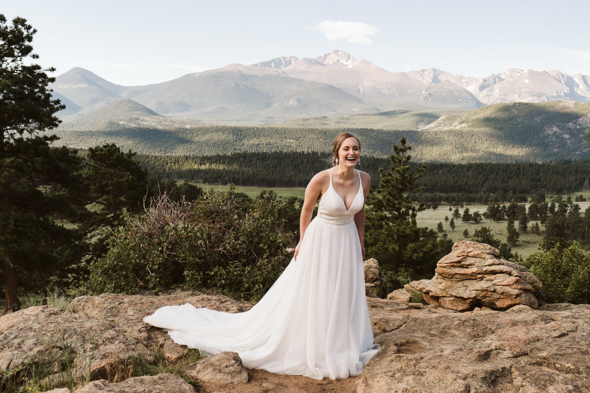 Bride in flowy dress with chiffon skirt, wedding dress for hiking elopement, Colorado wedding photographer