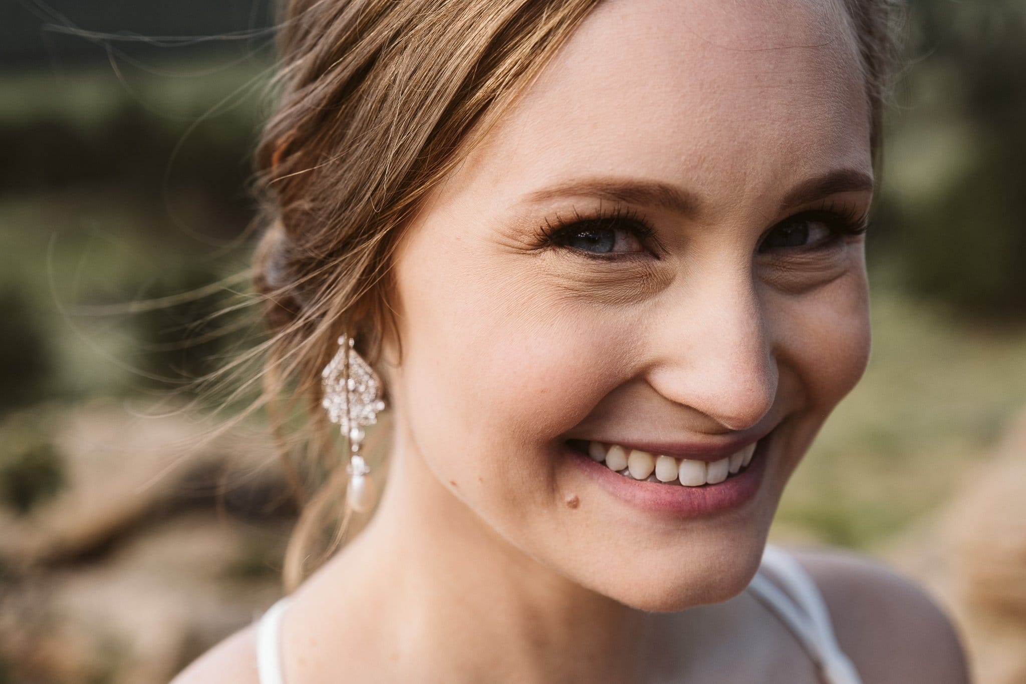 Classic bride makeup look with hair in low bun