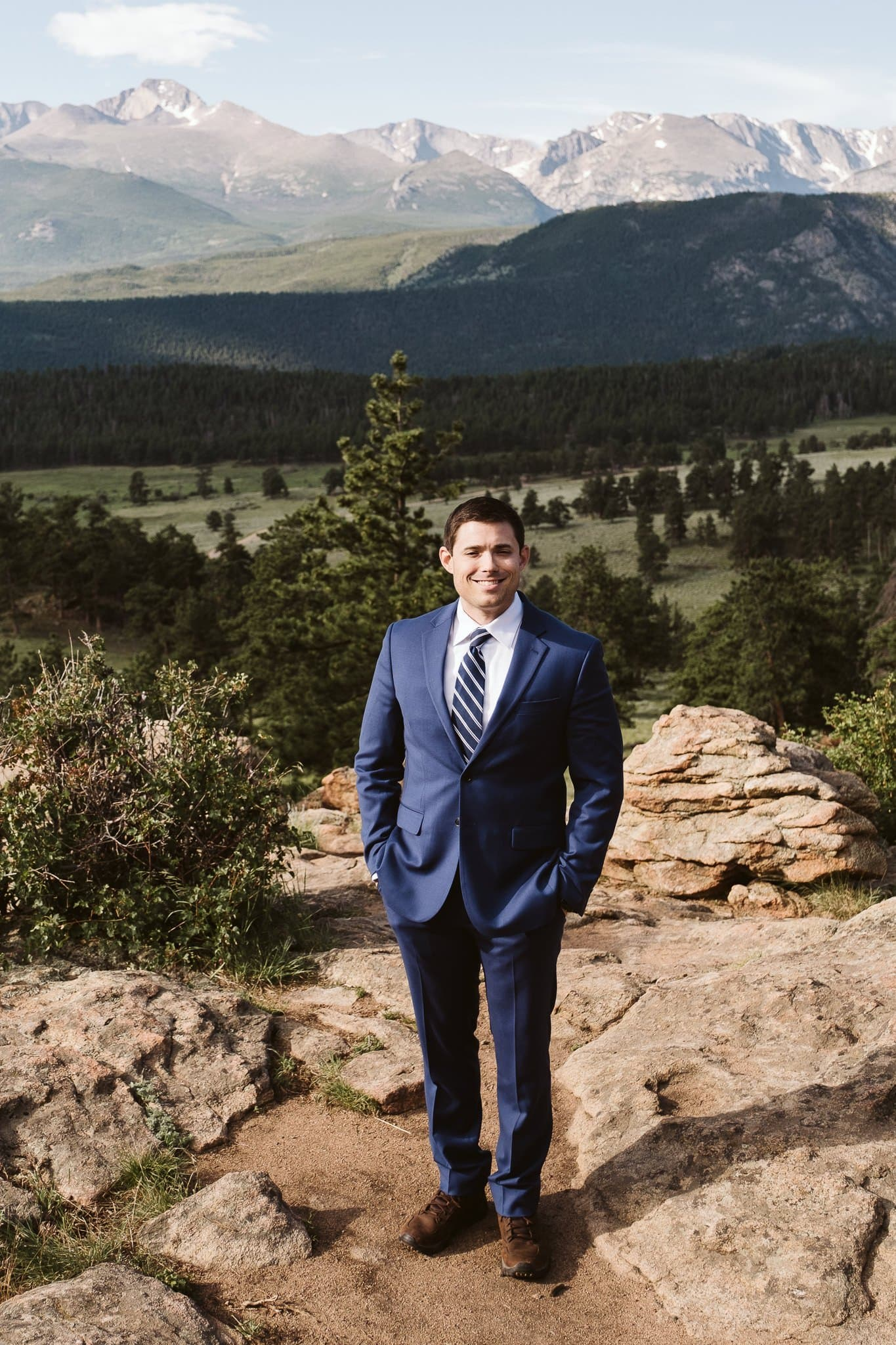 Groom in blue suit for mountain elopement, Colorado groom