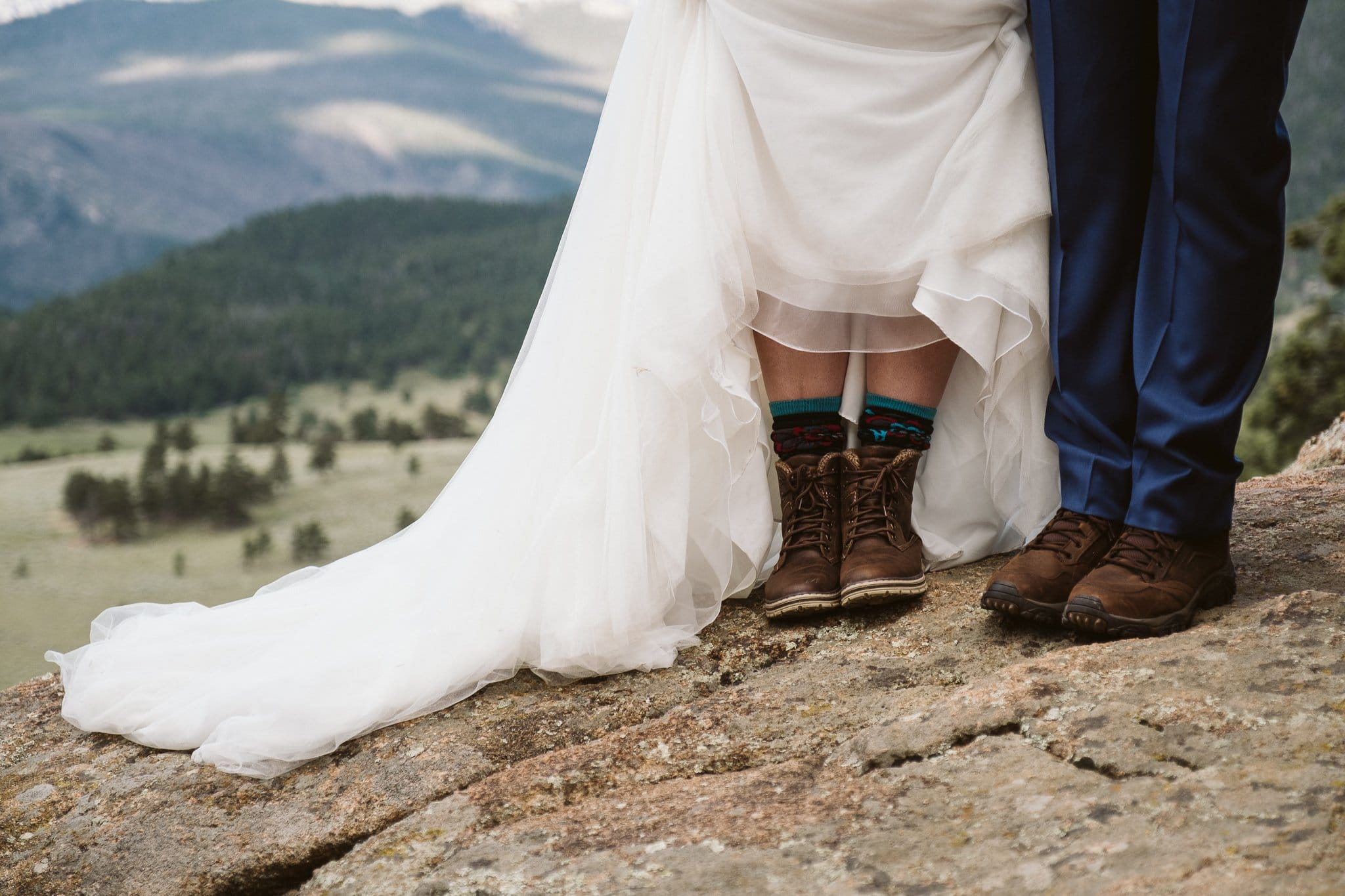 Bride and groom in hiking boots, Colorado adventure elopement