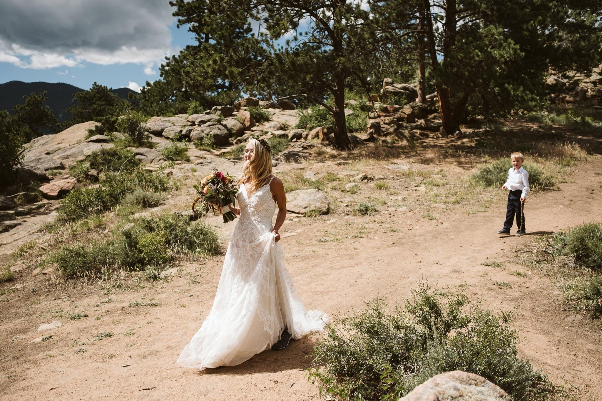 Bride walking down the trail / aisle with her son, Rocky Mountain National Park elopement at 3M Curve, Colorado wedding photographer
