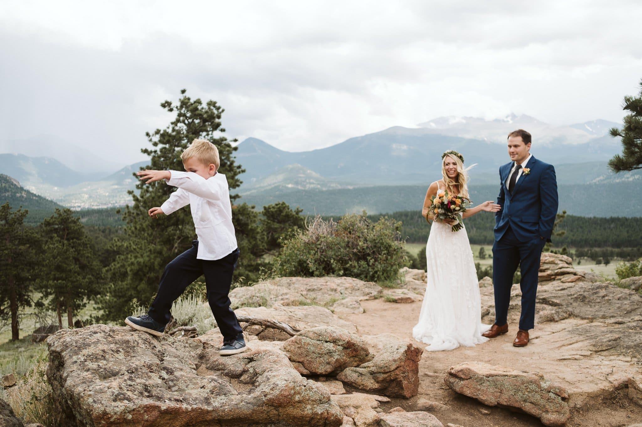 Wedding photos at 3M Curve in Rocky Mountain National Park, Estes Park wedding, Colorado wedding photographer, bride and groom with son