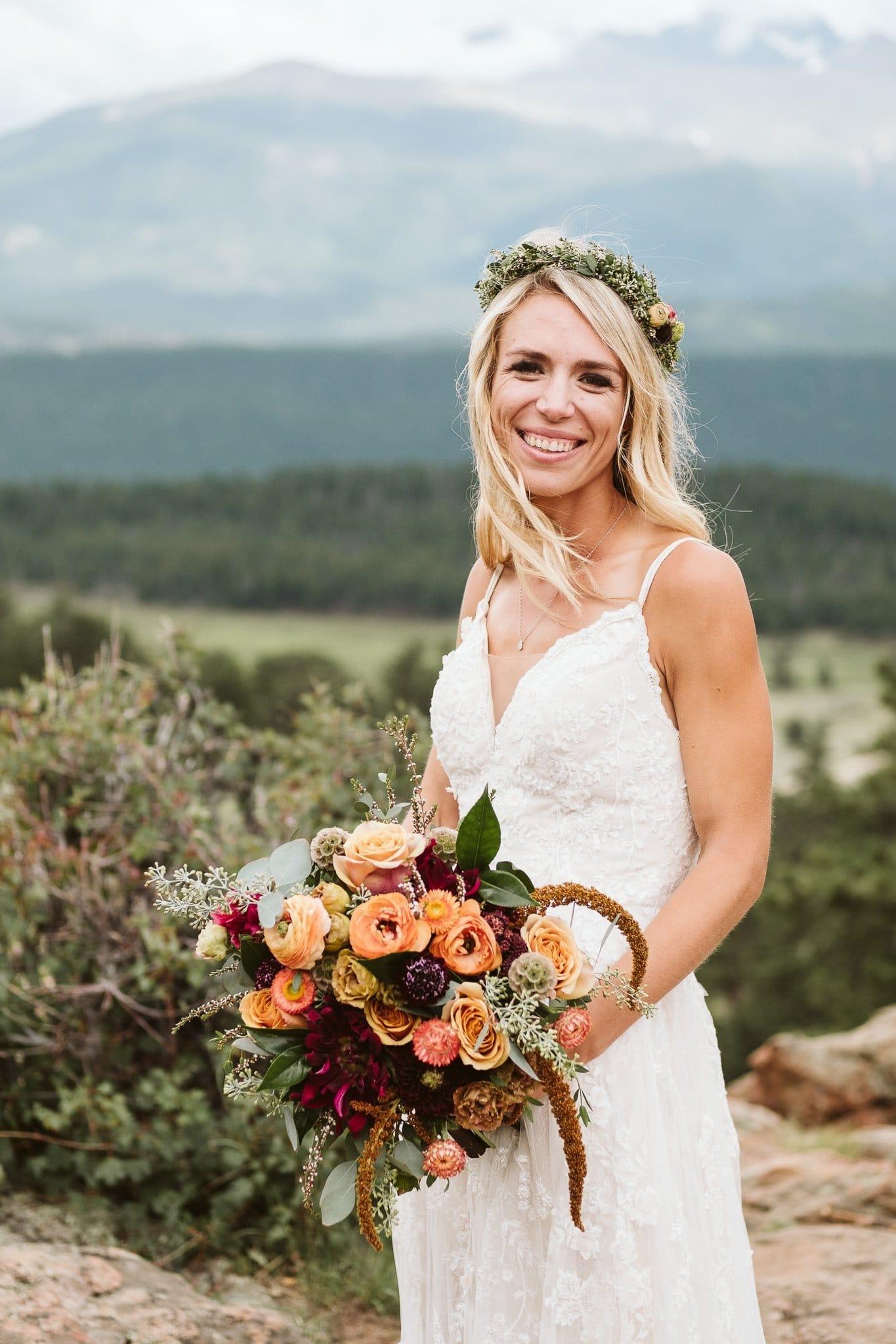 Wedding photos at 3M Curve in Rocky Mountain National Park, Estes Park wedding, Colorado wedding photographer, boho bride with floral crown and wild autumn color bouquet