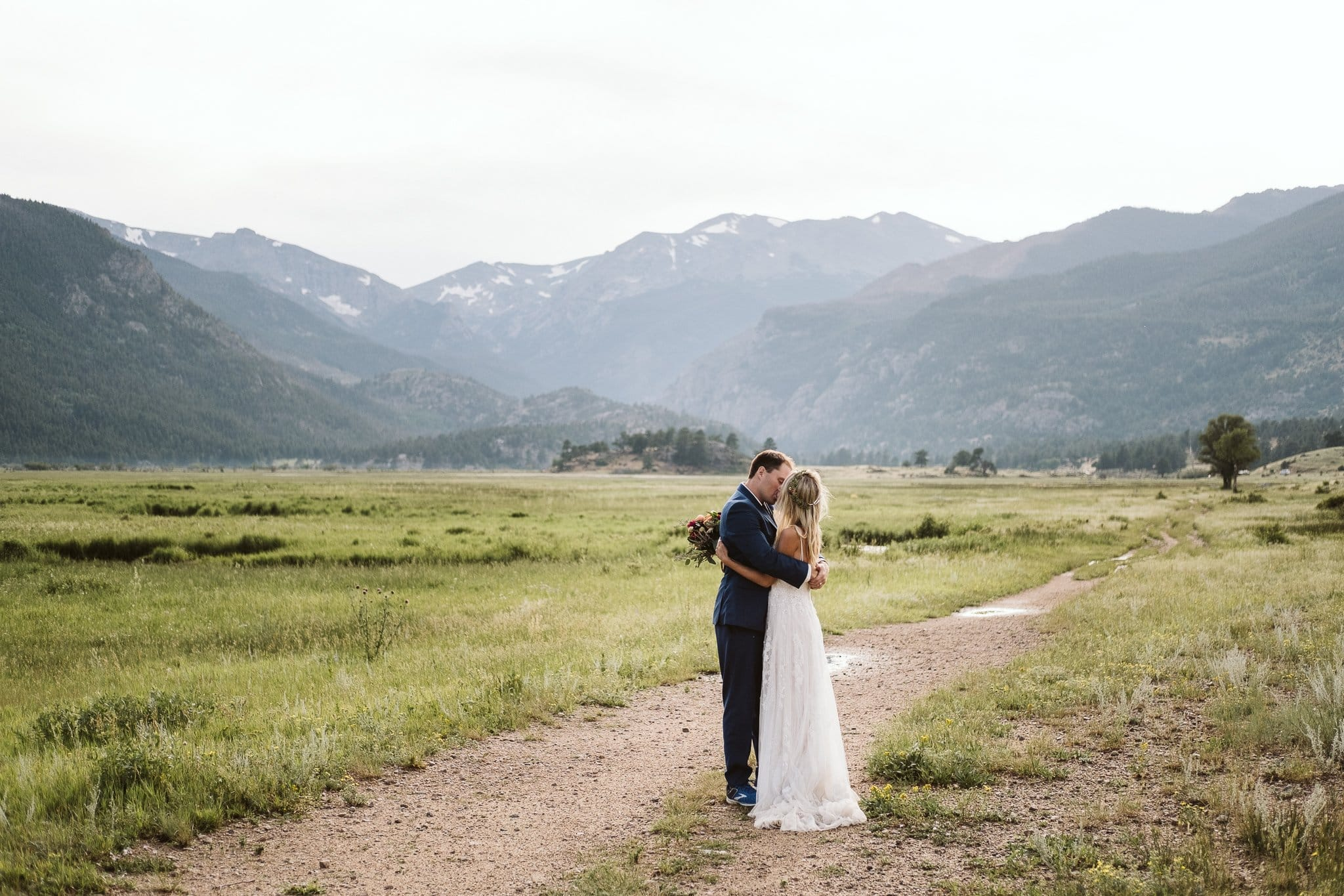 Bride and groom hiking in Moraine Valley for Rocky Mountain National Park elopement, Colorado elopement photographer, adventure elopement