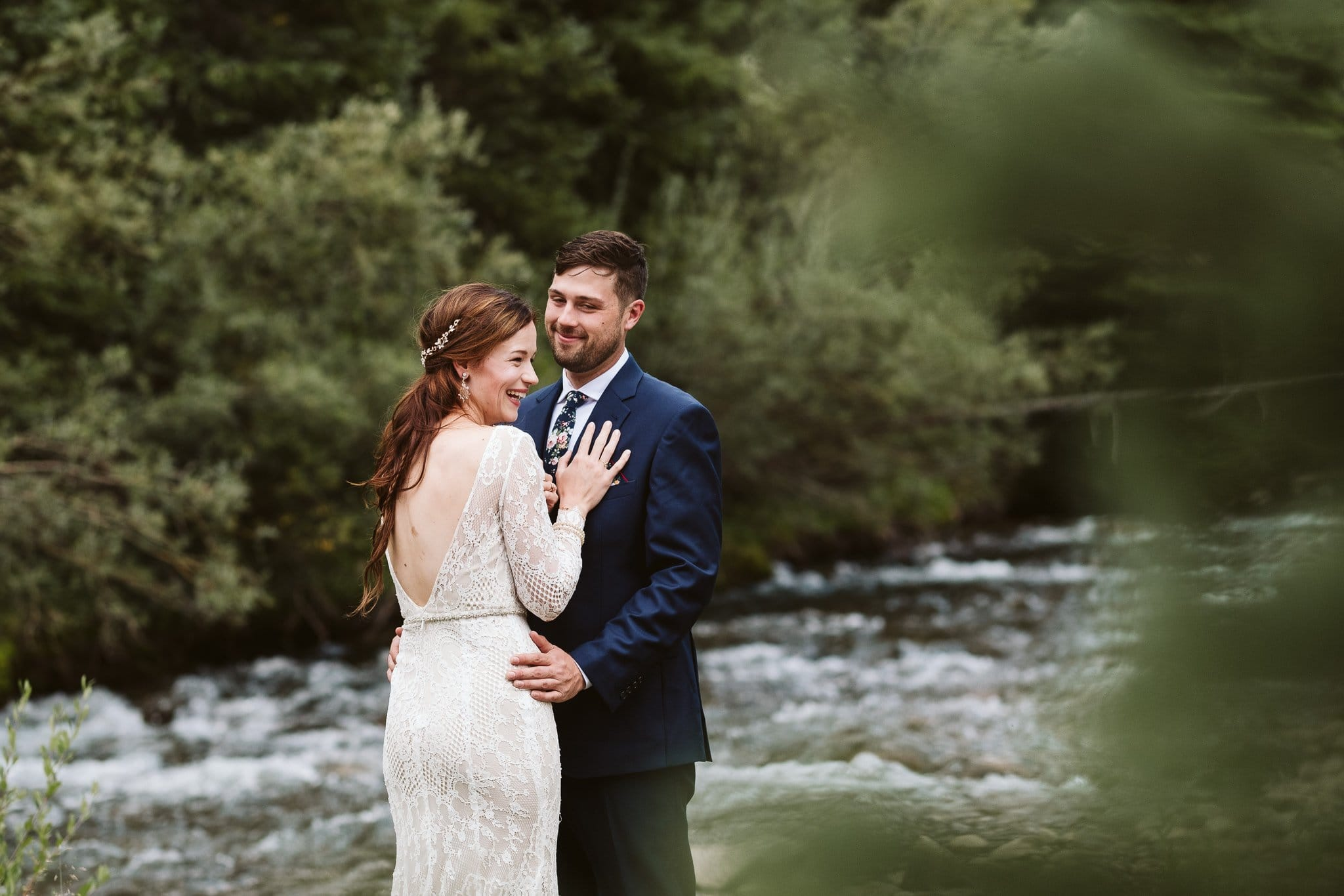 Bride and groom first look by a river in Colorado, Rivertree Lodge wedding photographer