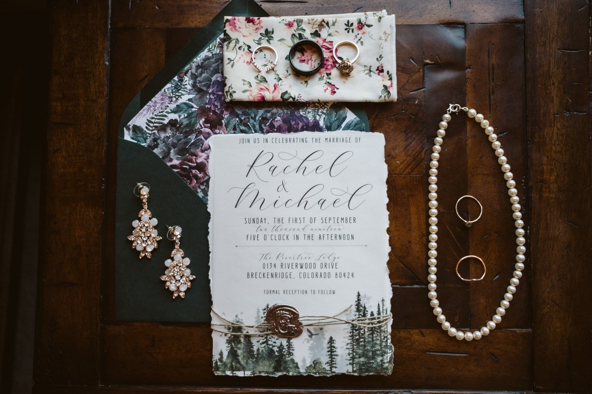Wedding details with invitations and jewelry