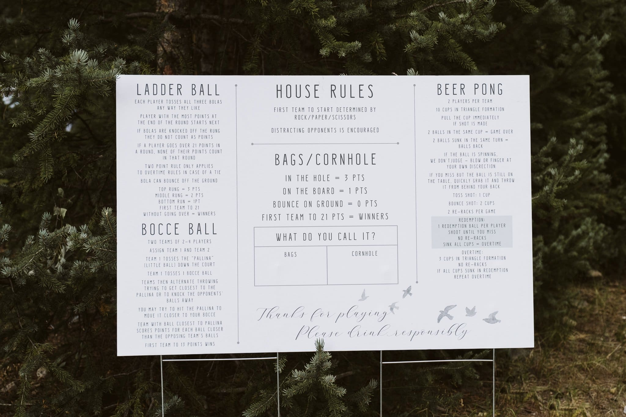 Yard games rules on sign and easel for an intimate wedding in the woods