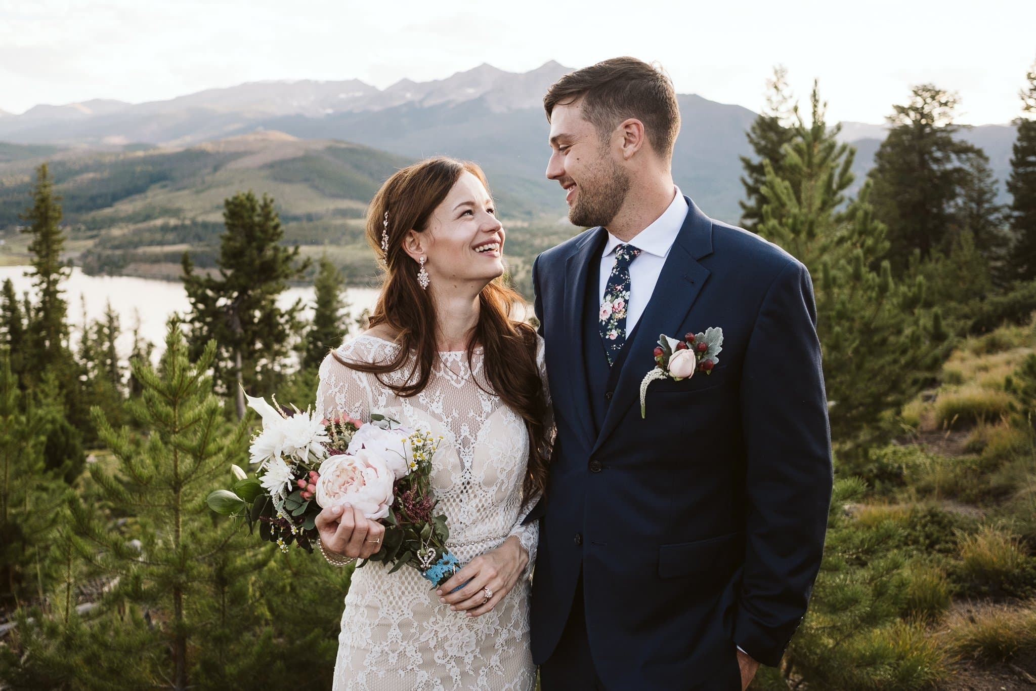 Bride and groom wedding portraits at Sapphire Point in Dillon, Colorado mountain wedding photos
