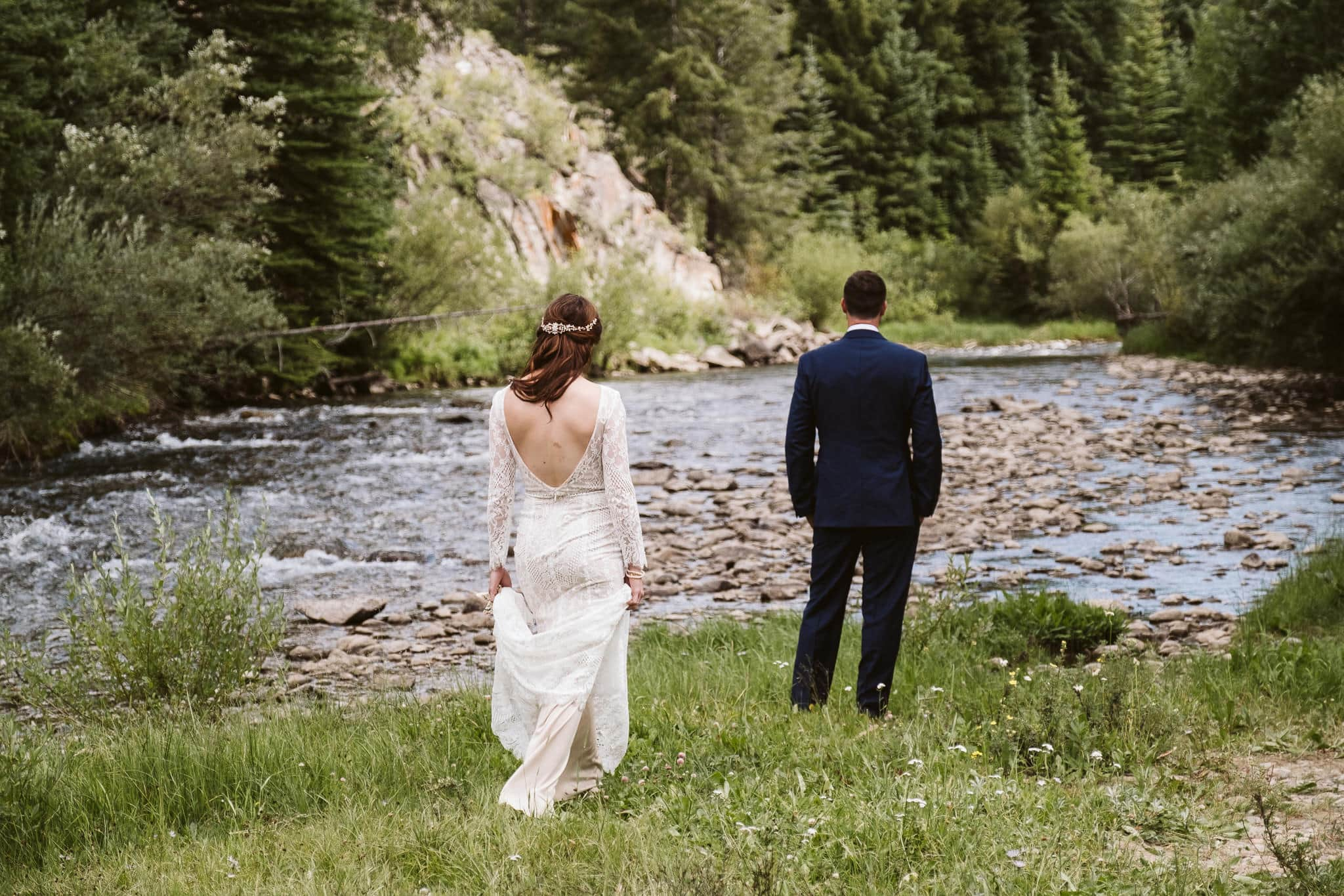 Bride and groom do first look near Blue River in Breckenridge.