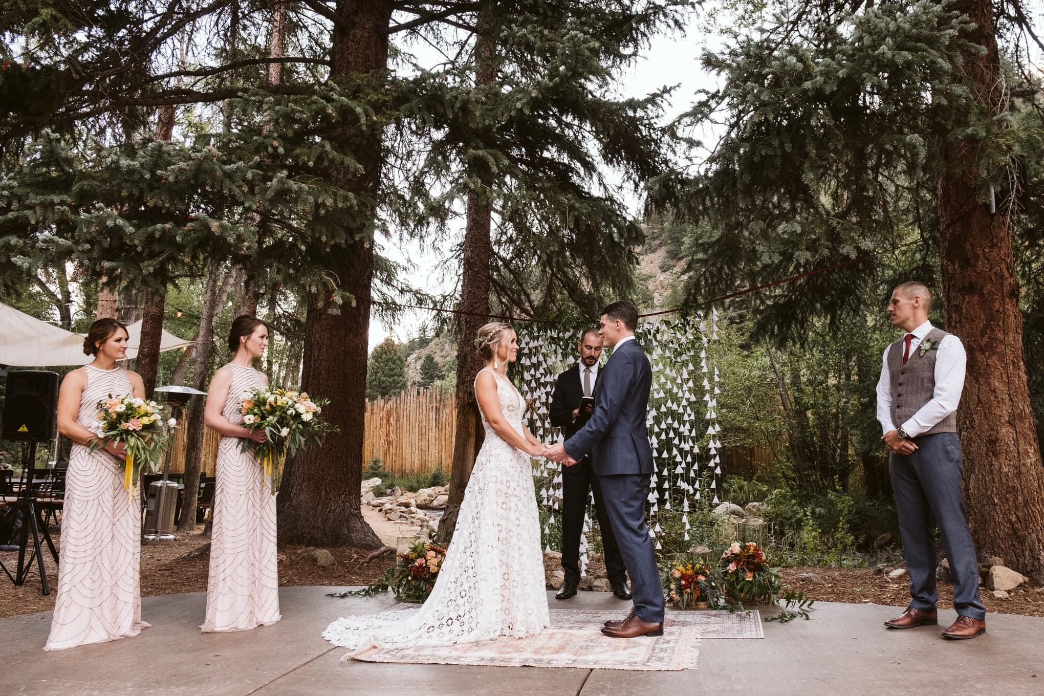 Wedding ceremony at Blackstone Rivers Ranch wedding venue in Idaho Springs