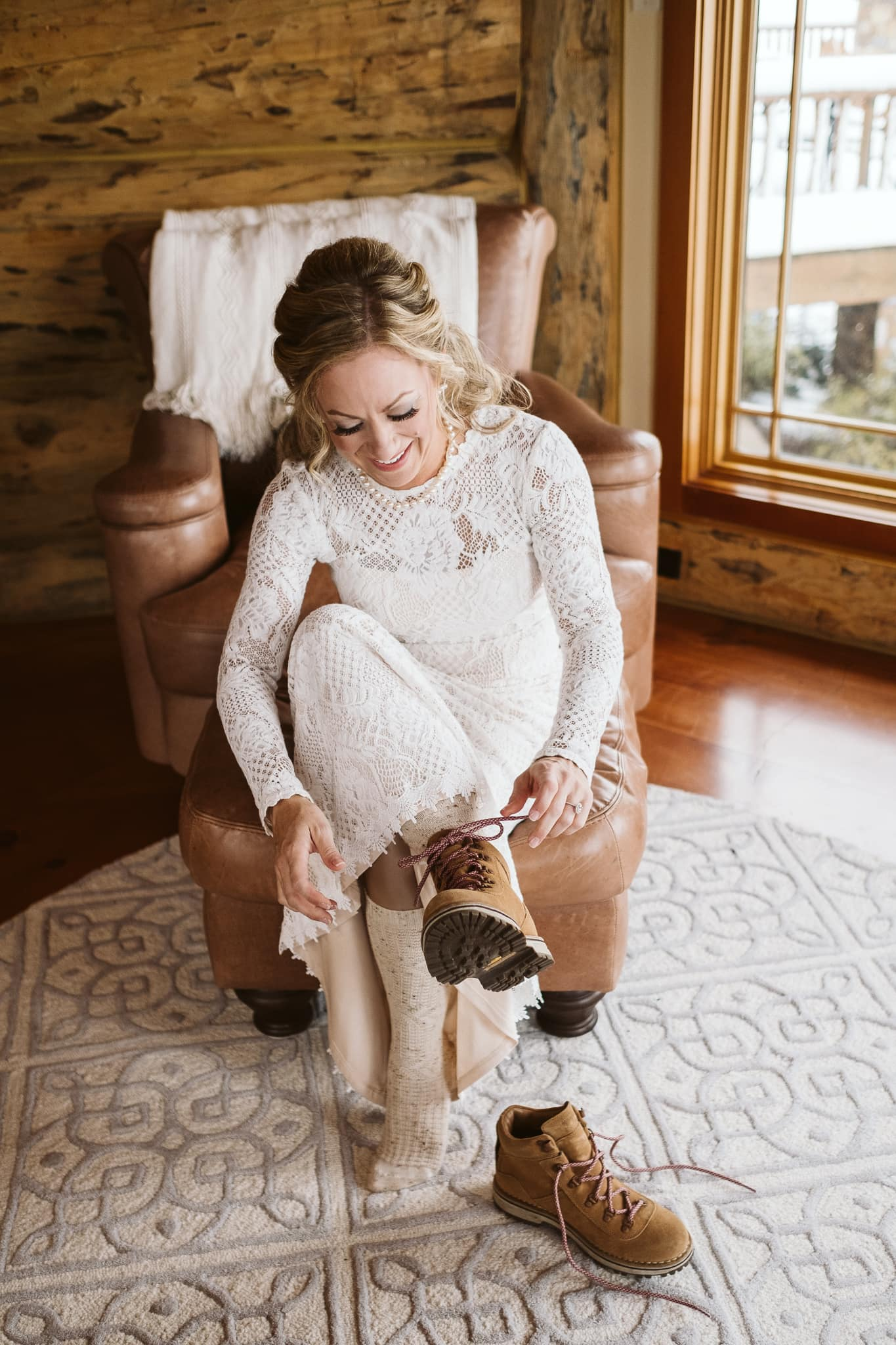 Bride getting ready for elopement in log mountain home in Steamboat Springs