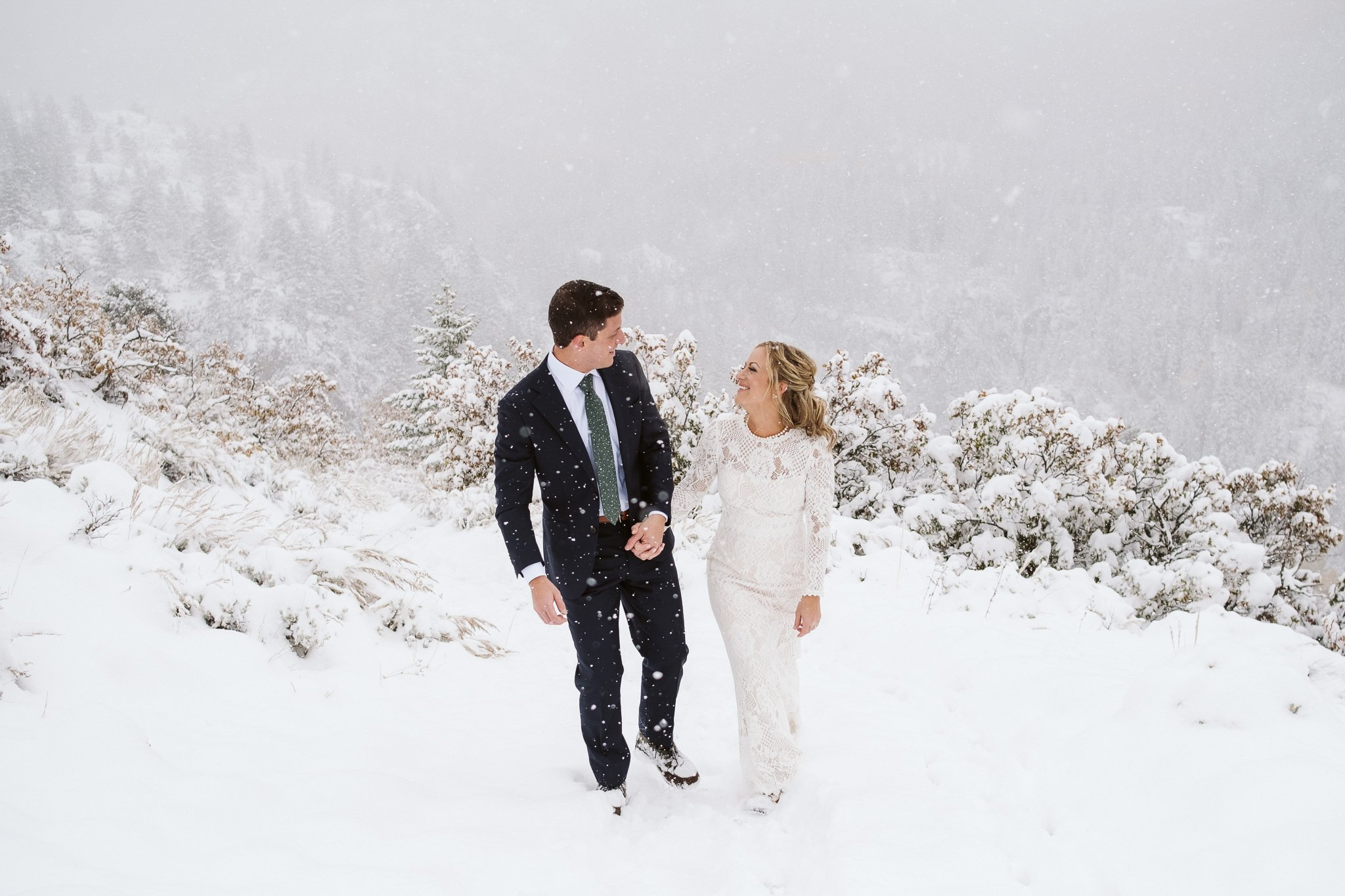 Bride and groom hiking in snow at Steamboat Springs elopement in winter