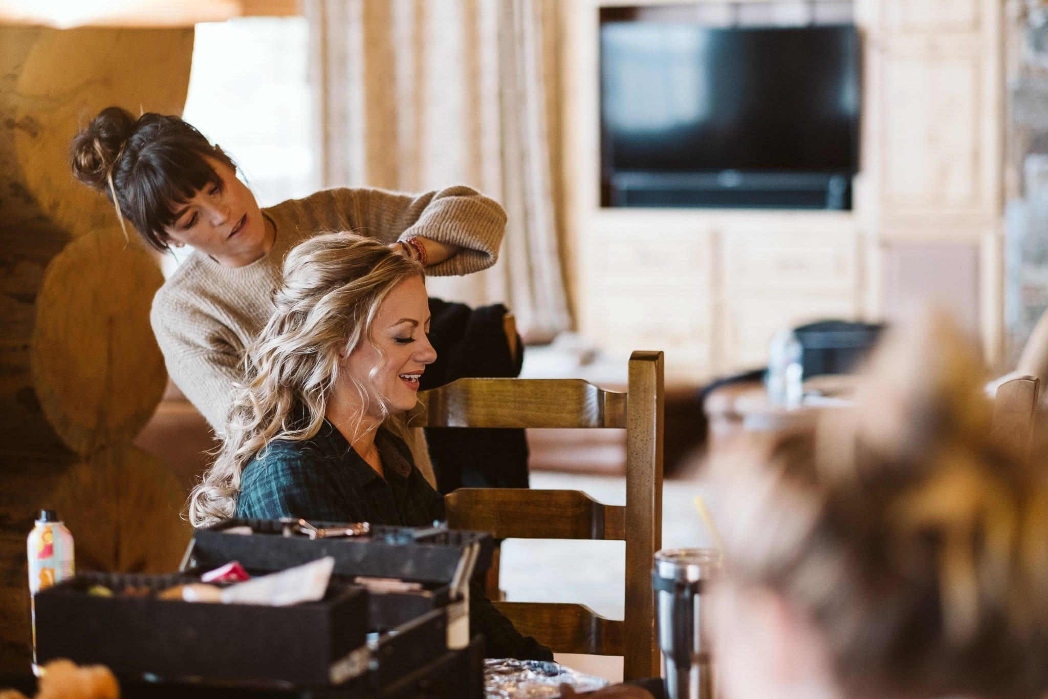 Bride getting ready in log mountain home in Steamboat Springs