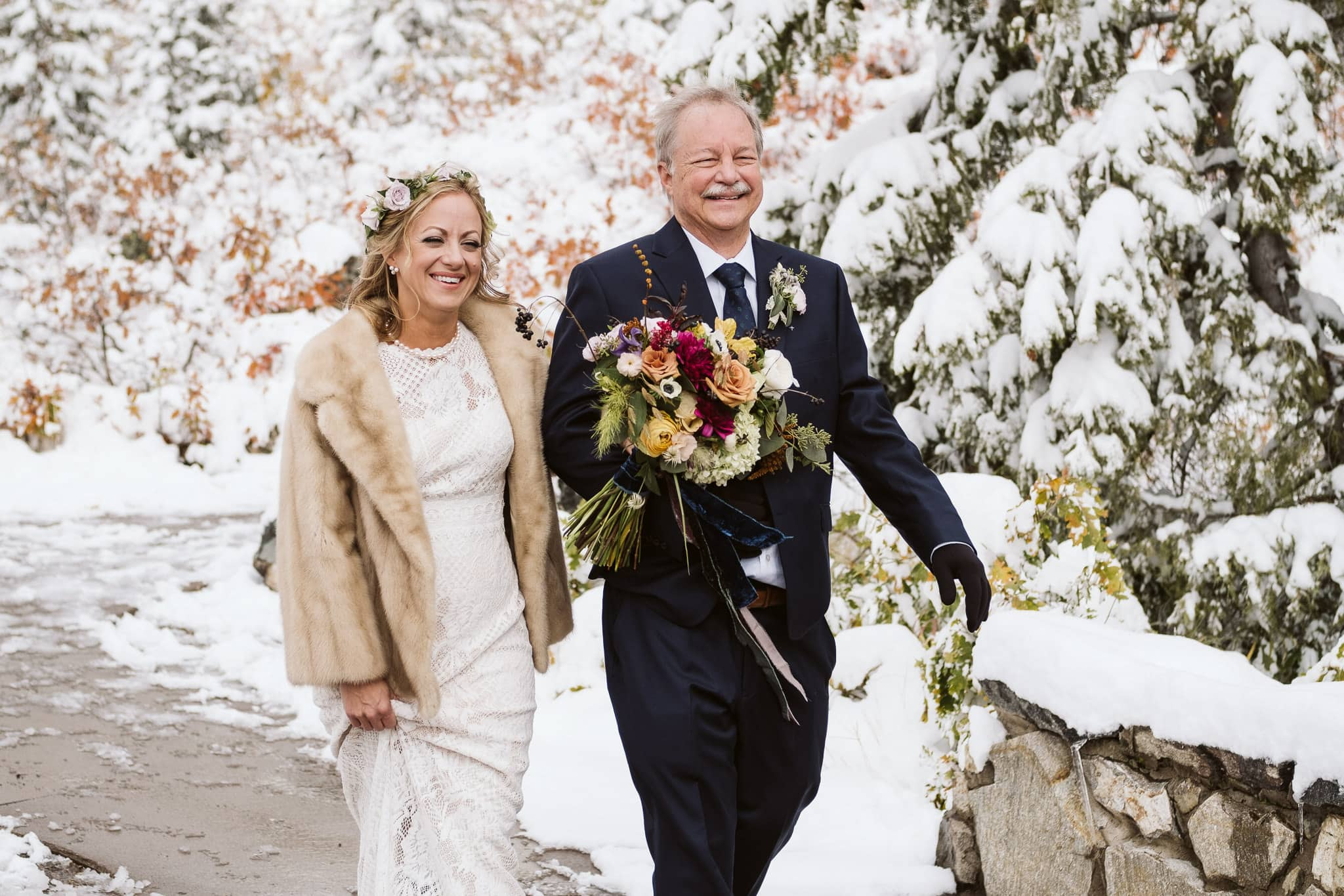 Bride walks down the aisle with her father at Fish Creek Falls wedding in Steamboat Springs