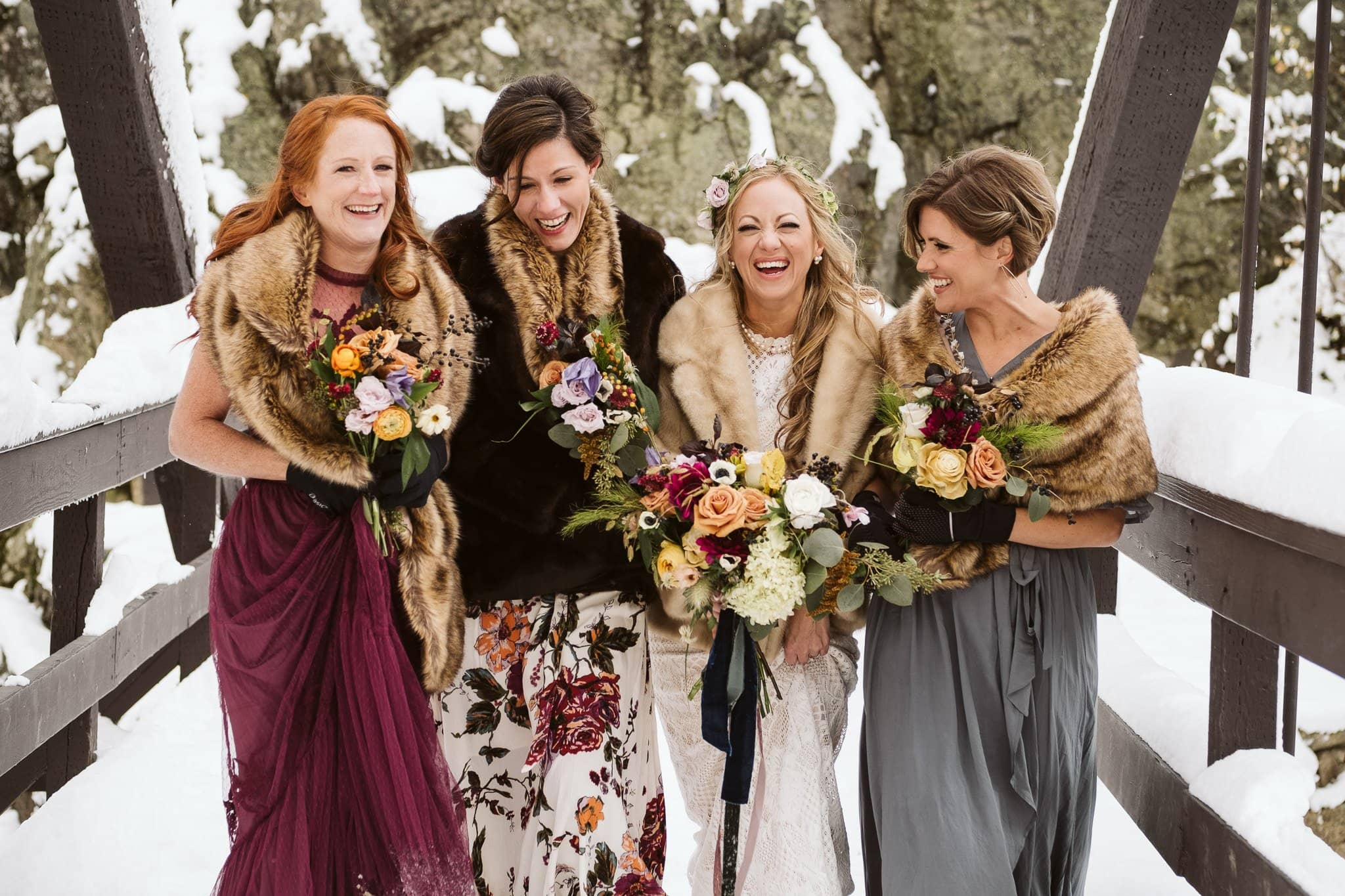 Bride with bridesmaids at Fish Creek Falls in Steamboat Springs, Colorado winter elopement