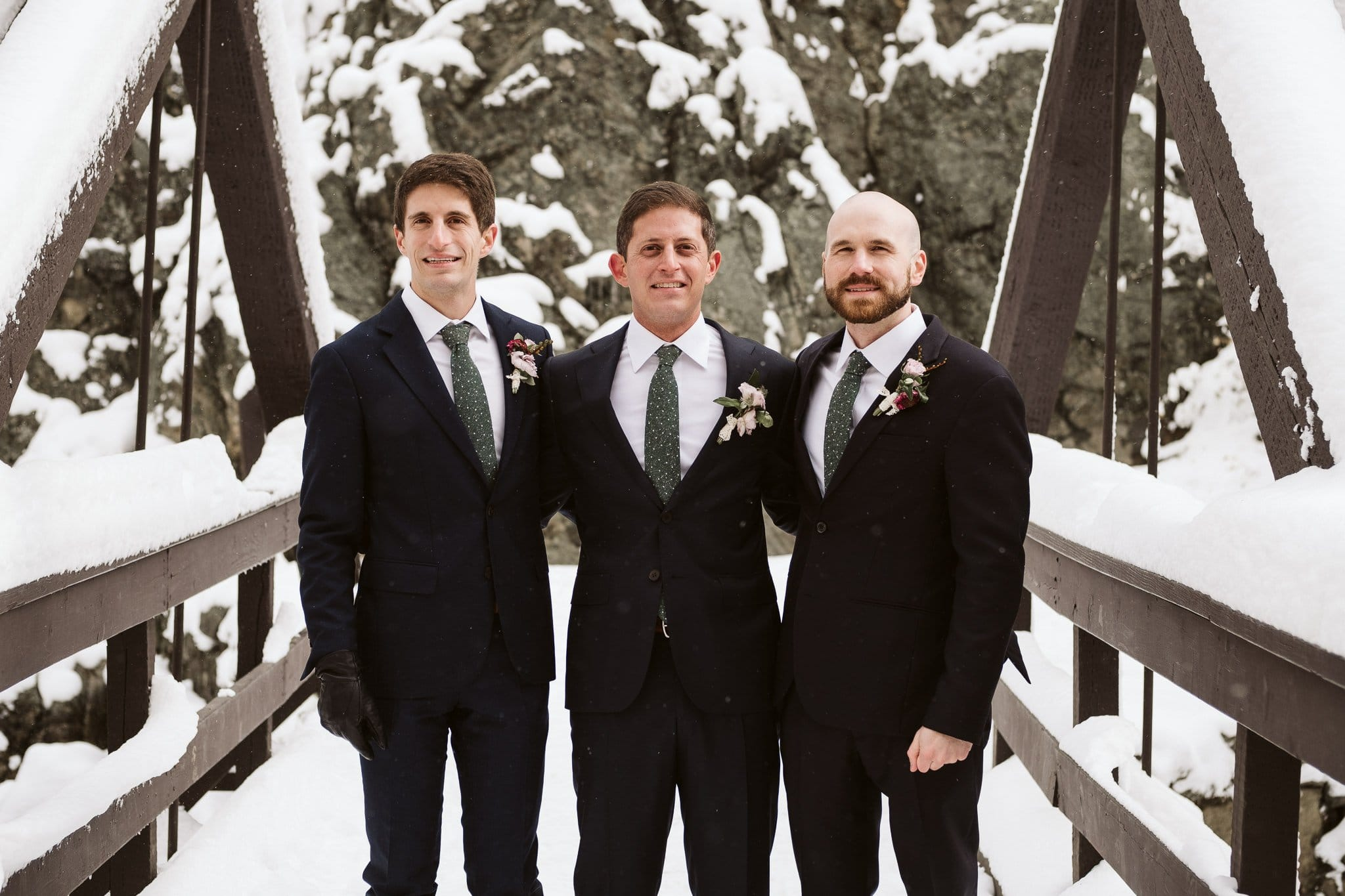Groom and groomsmen at Fish Creek Falls in Steamboat Springs, Colorado winter elopement