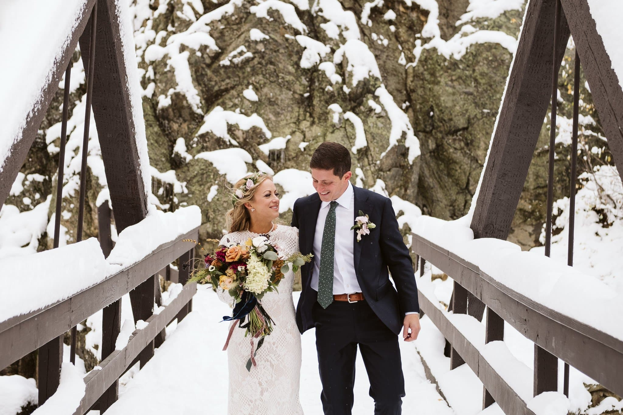 Bride and groom portraits at Fish Creek Falls in Steamboat Springs, Colorado winter elopement