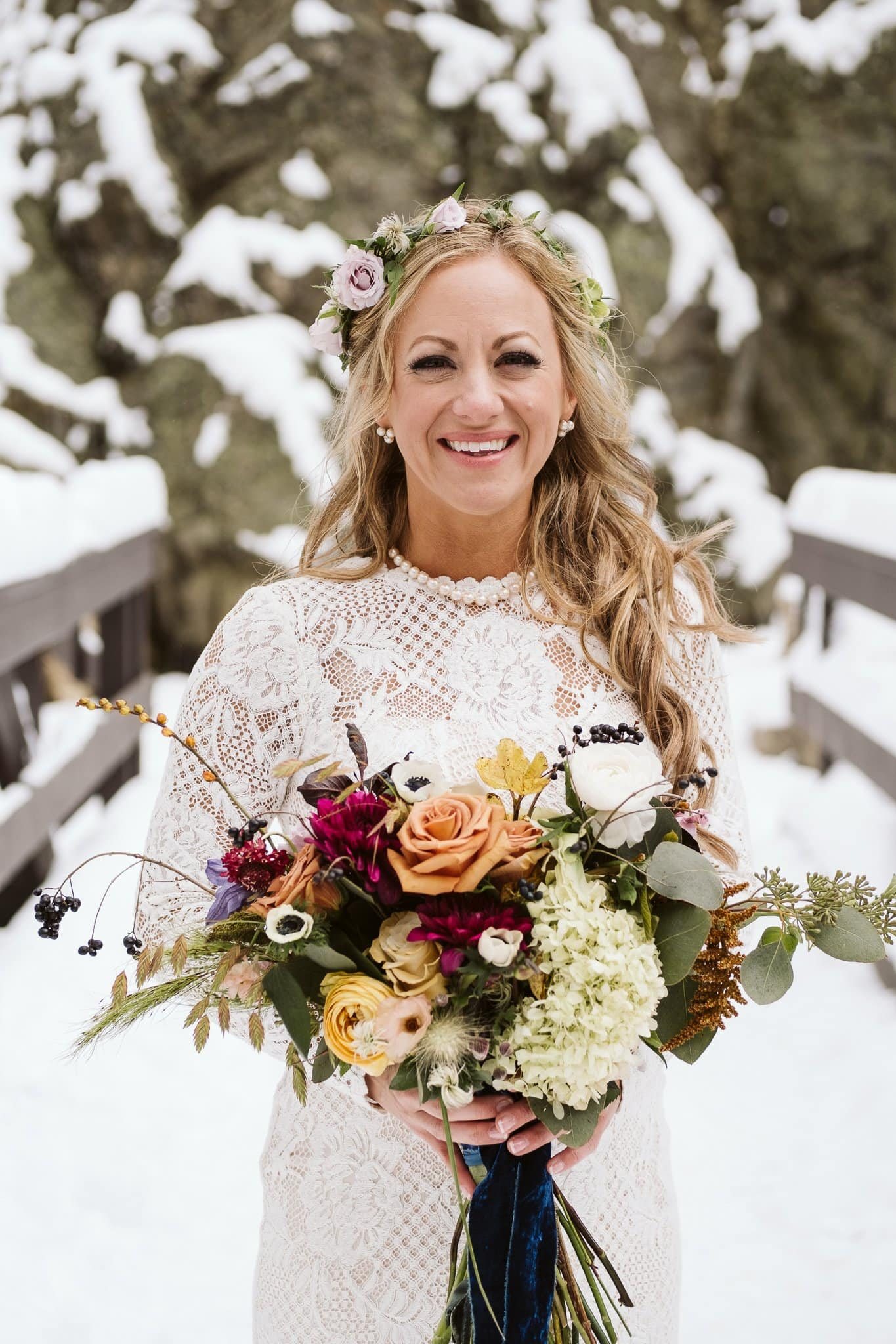 Bridal portraits at Fish Creek Falls in Steamboat Springs, Colorado winter elopement