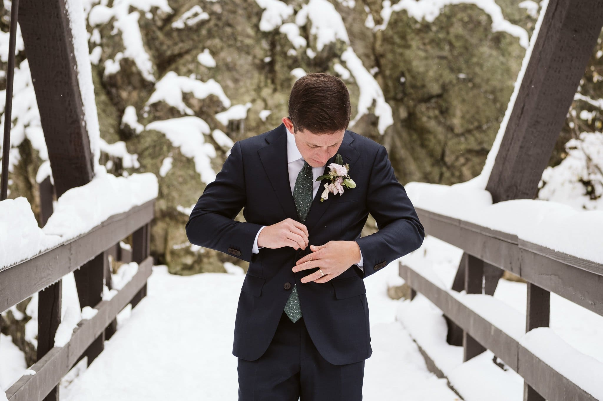 Groom portraits at Fish Creek Falls in Steamboat Springs, Colorado winter elopement