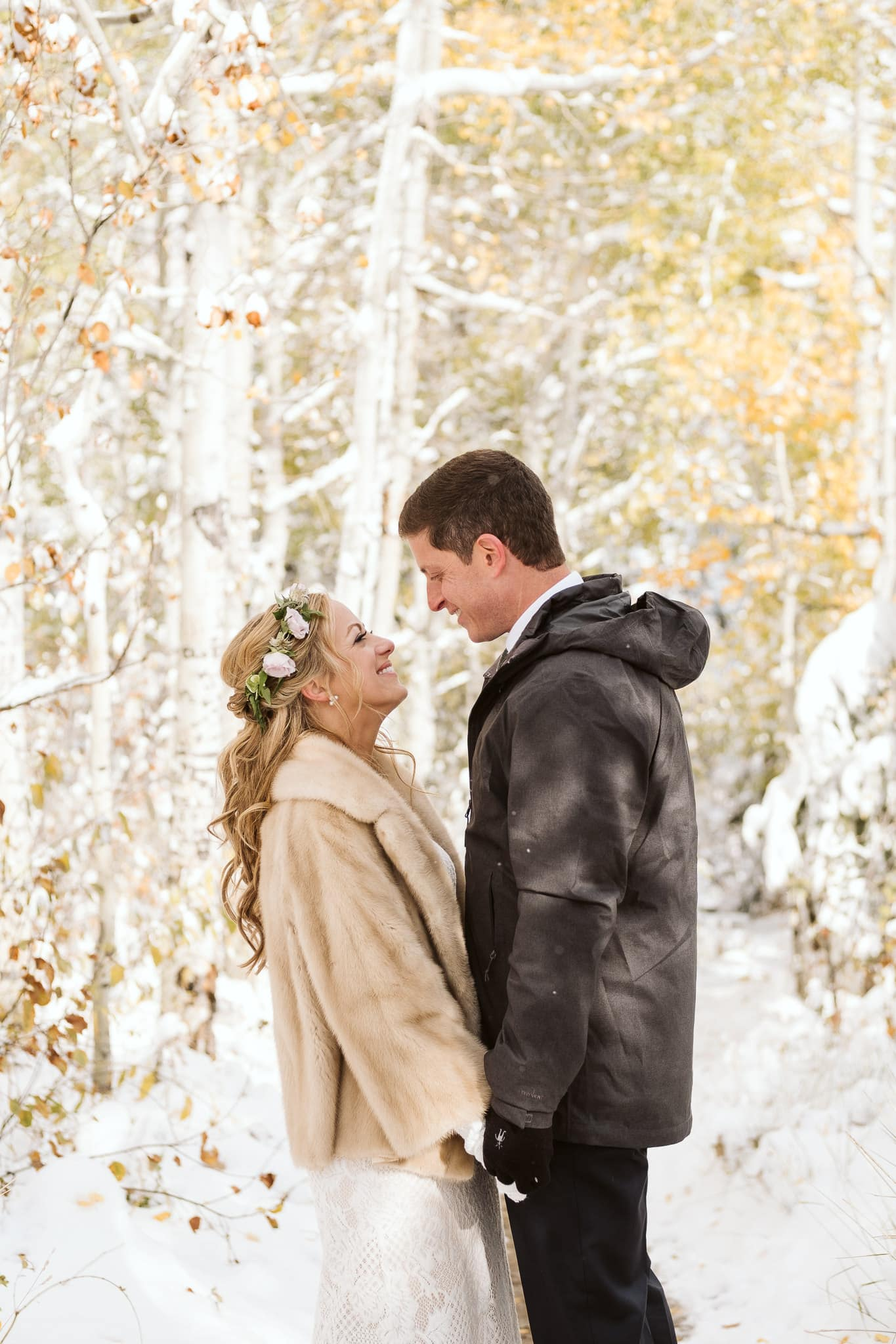 Bride and groom portraits in snow covered aspen trees in Steamboat Springs