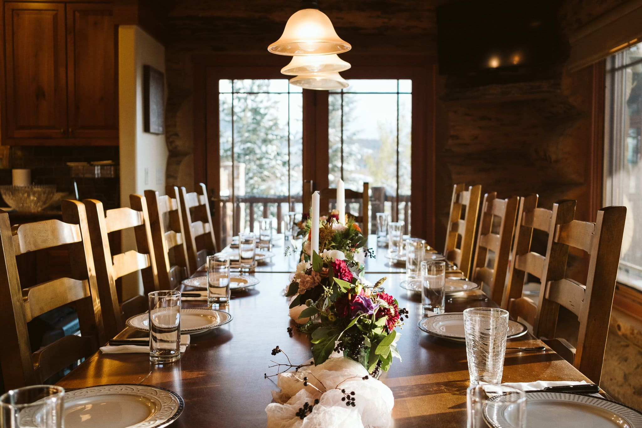 Decorated dining table for intimate elopement reception at private mountain home in the Colorado mountains