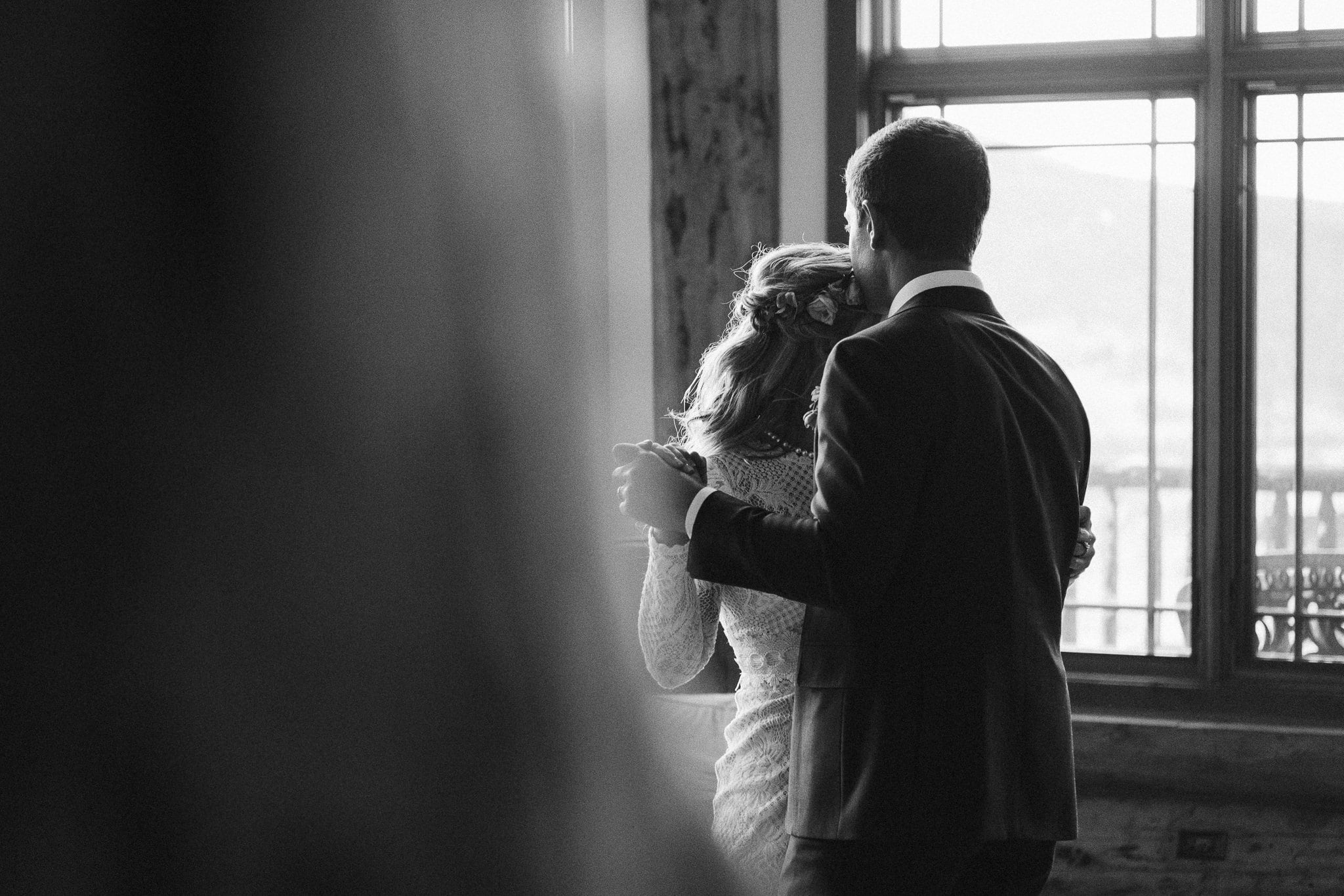 Bride and groom share first dance in the living room of a luxury mountain home in Steamboat Springs, intimate elopement in Colorado