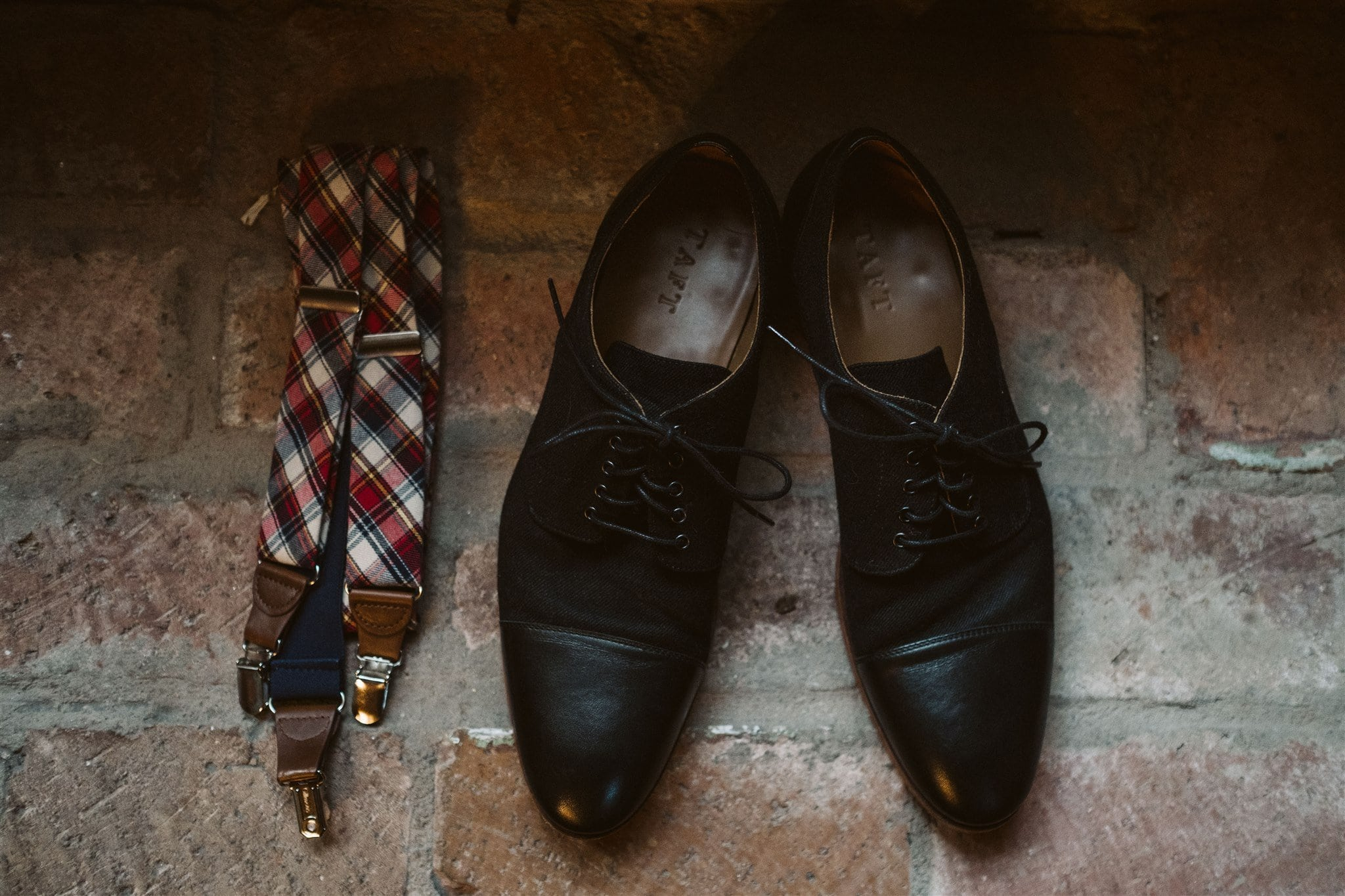 Groom's shoes and suspenders