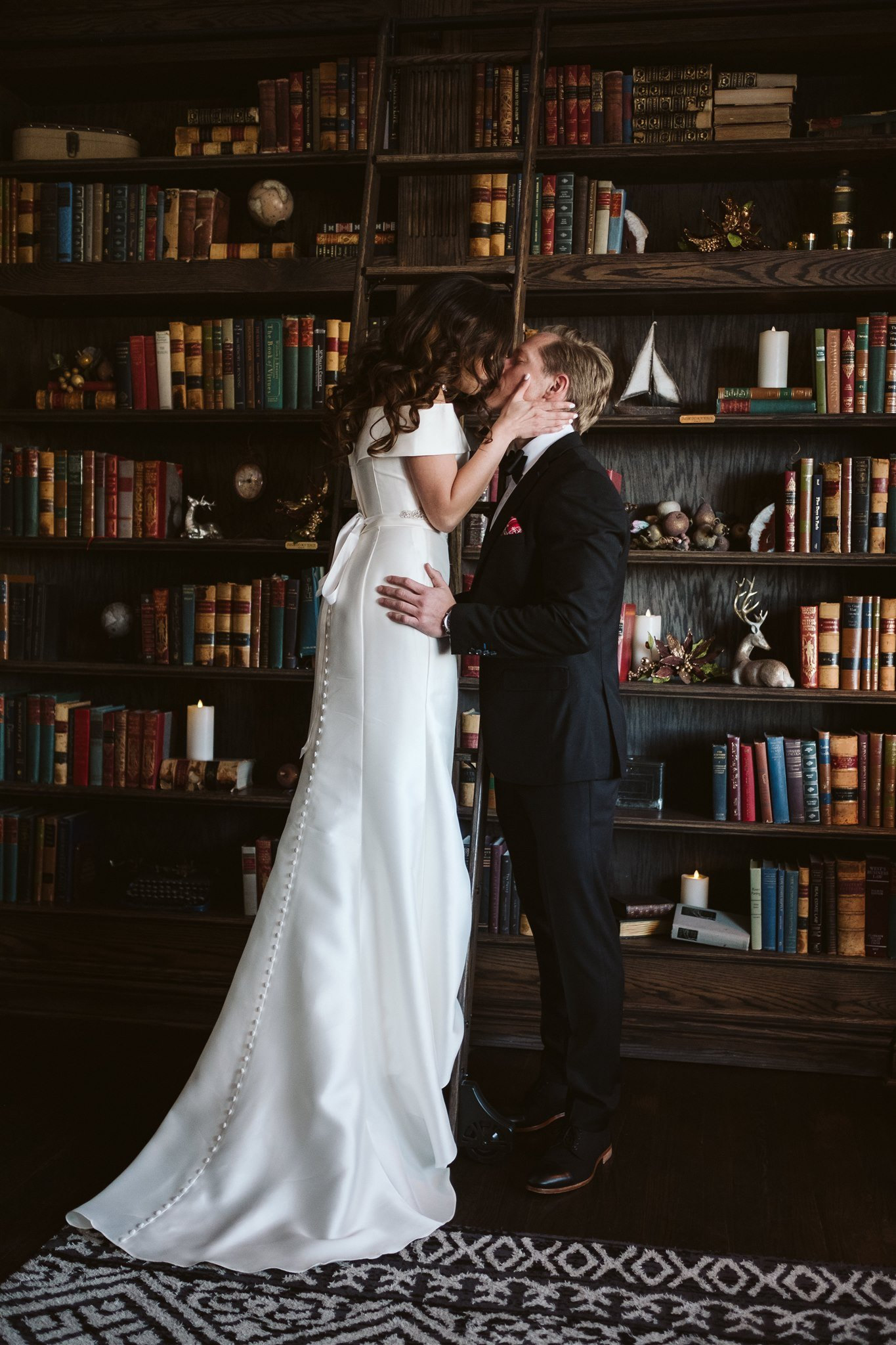 Bride and groom portrait in library at The Manor House wedding
