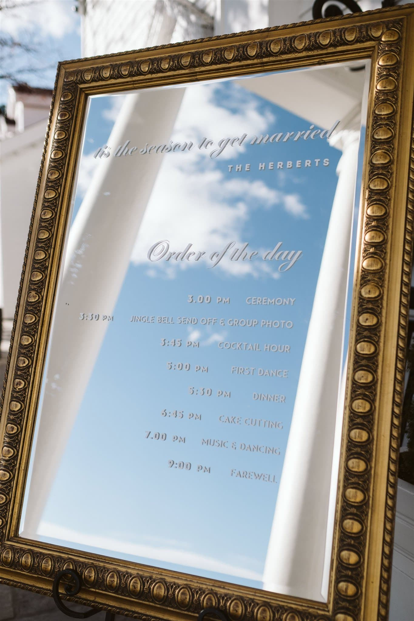 Wedding program written on mirror