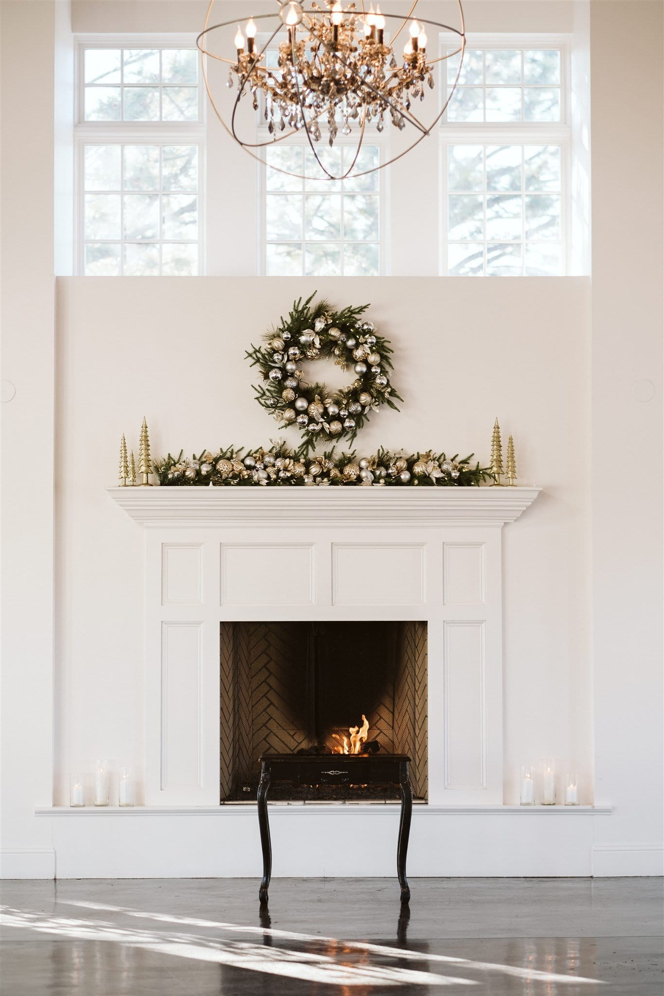 Christmas wedding ceremony in front of a fireplace