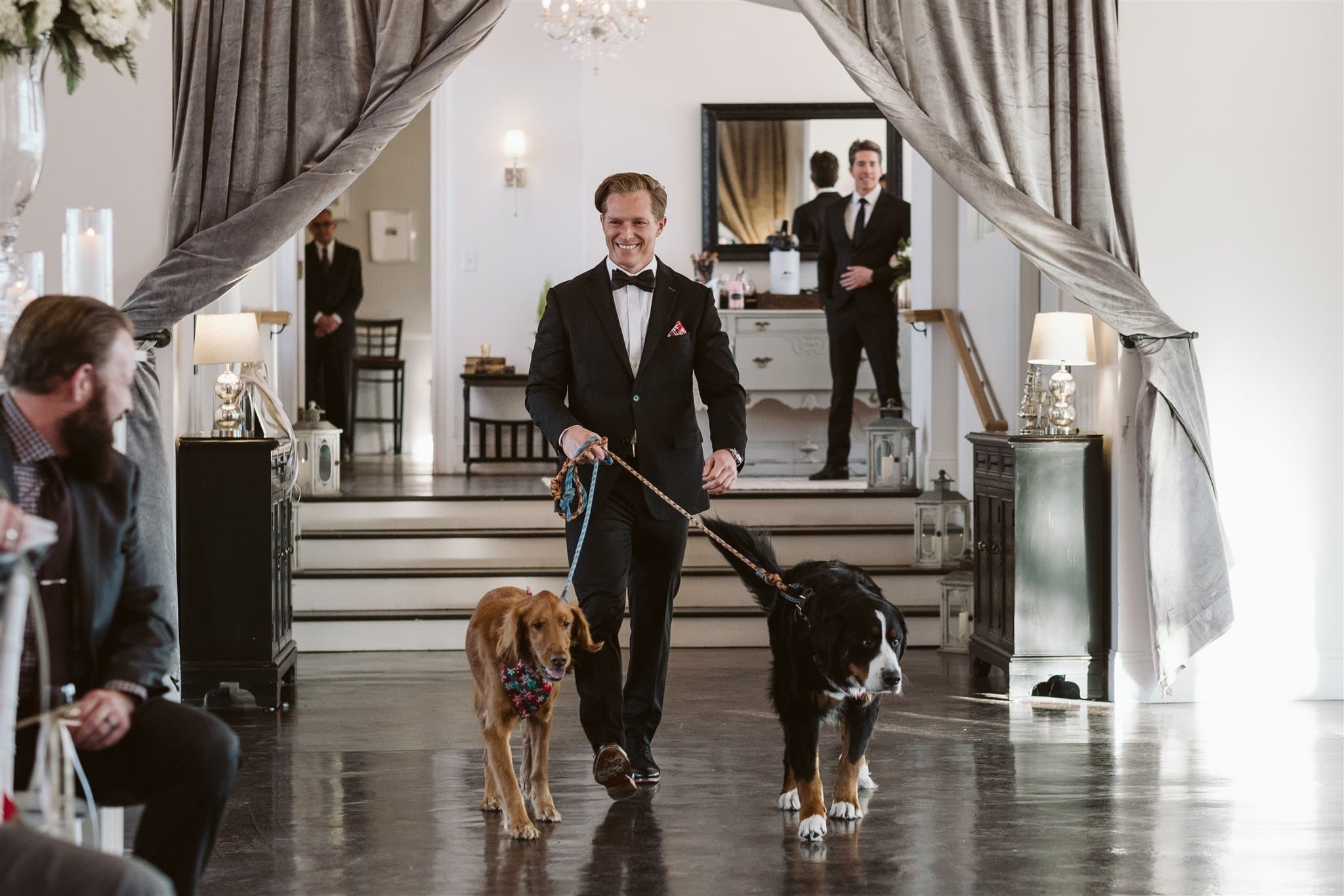 Groom walking dogs down the aisle at the Manor House