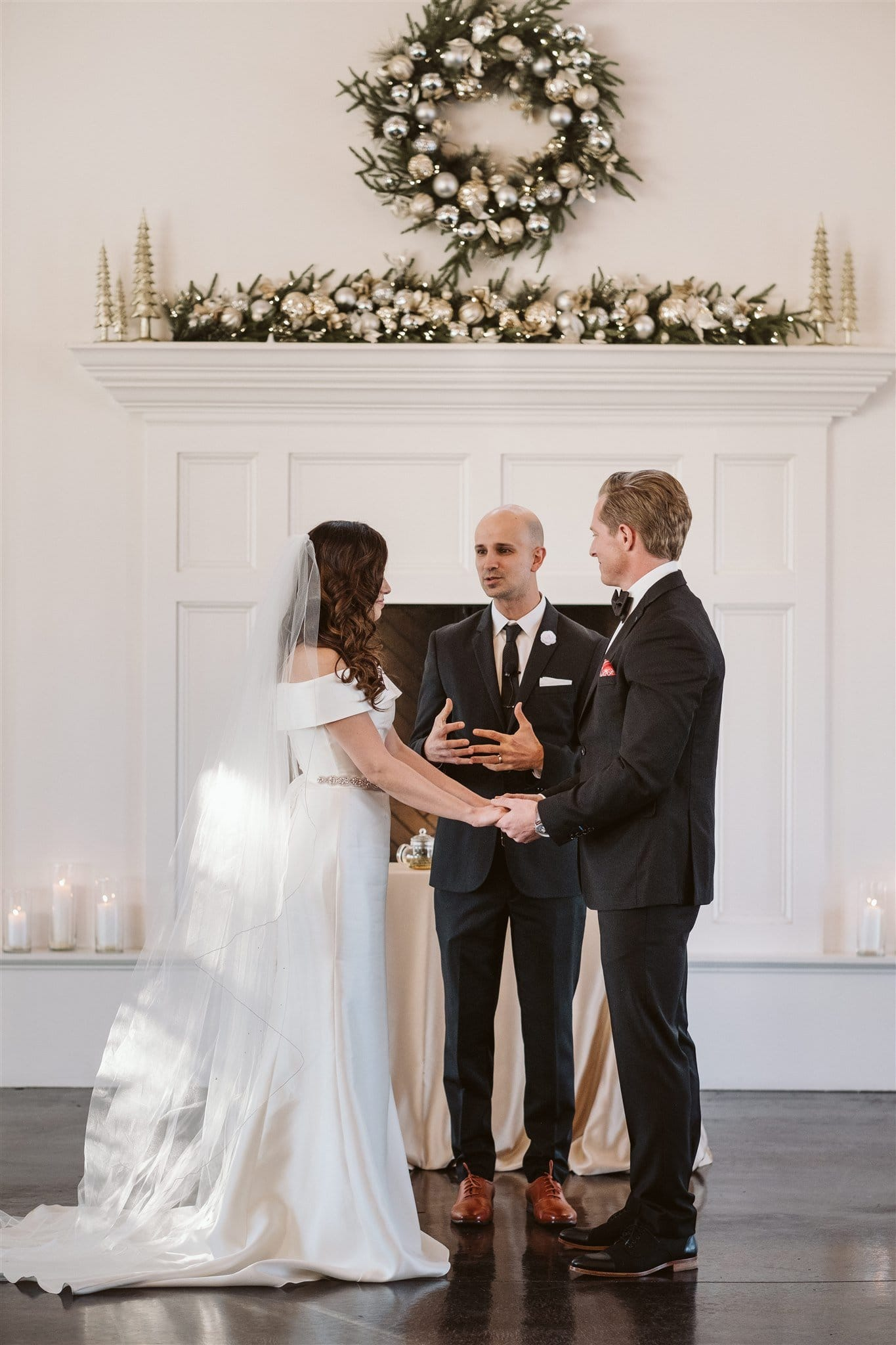 Christmas wedding ceremony in front of fireplace