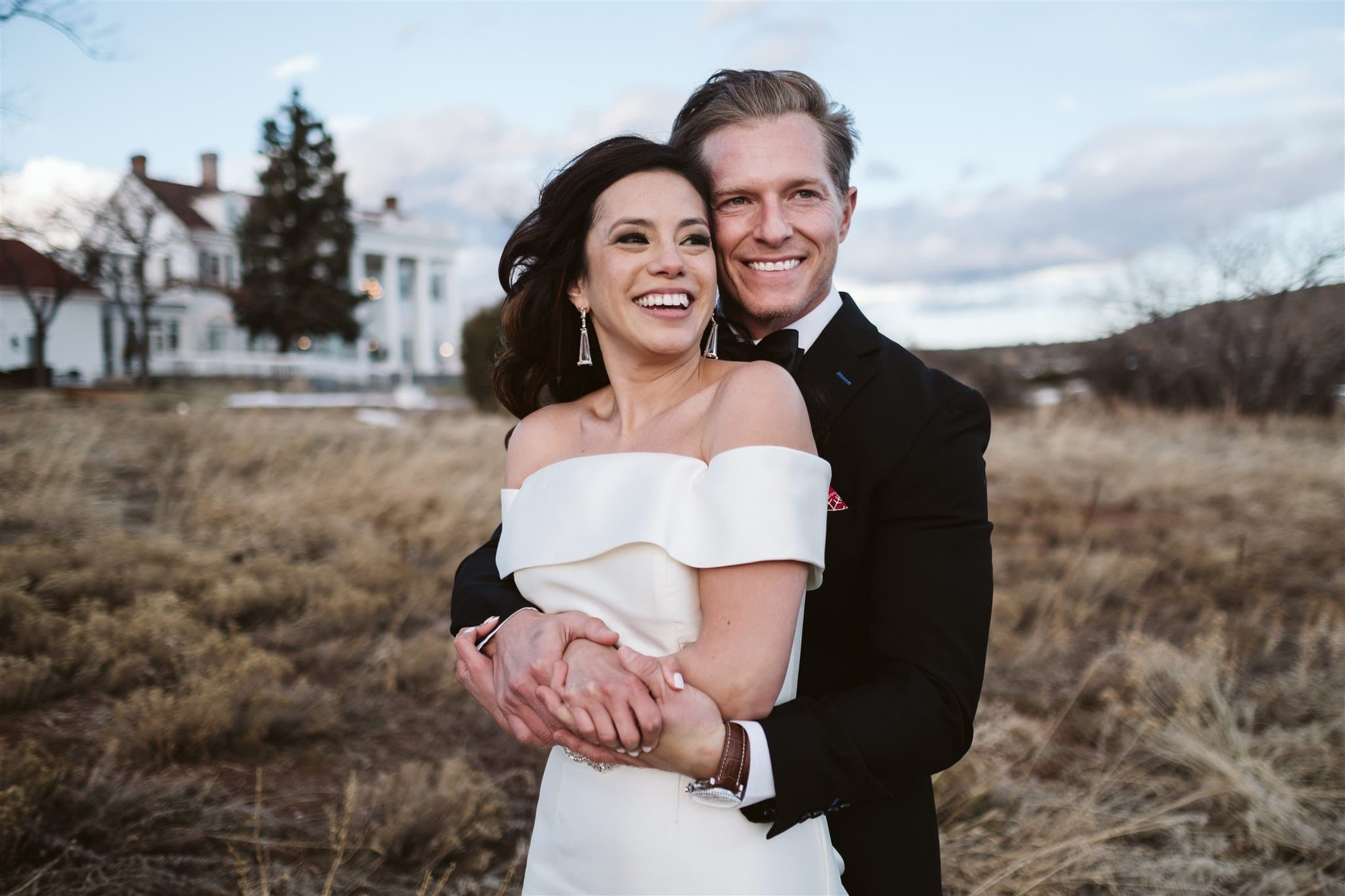 Bride and groom in front of a luxury wedding venue in Denver