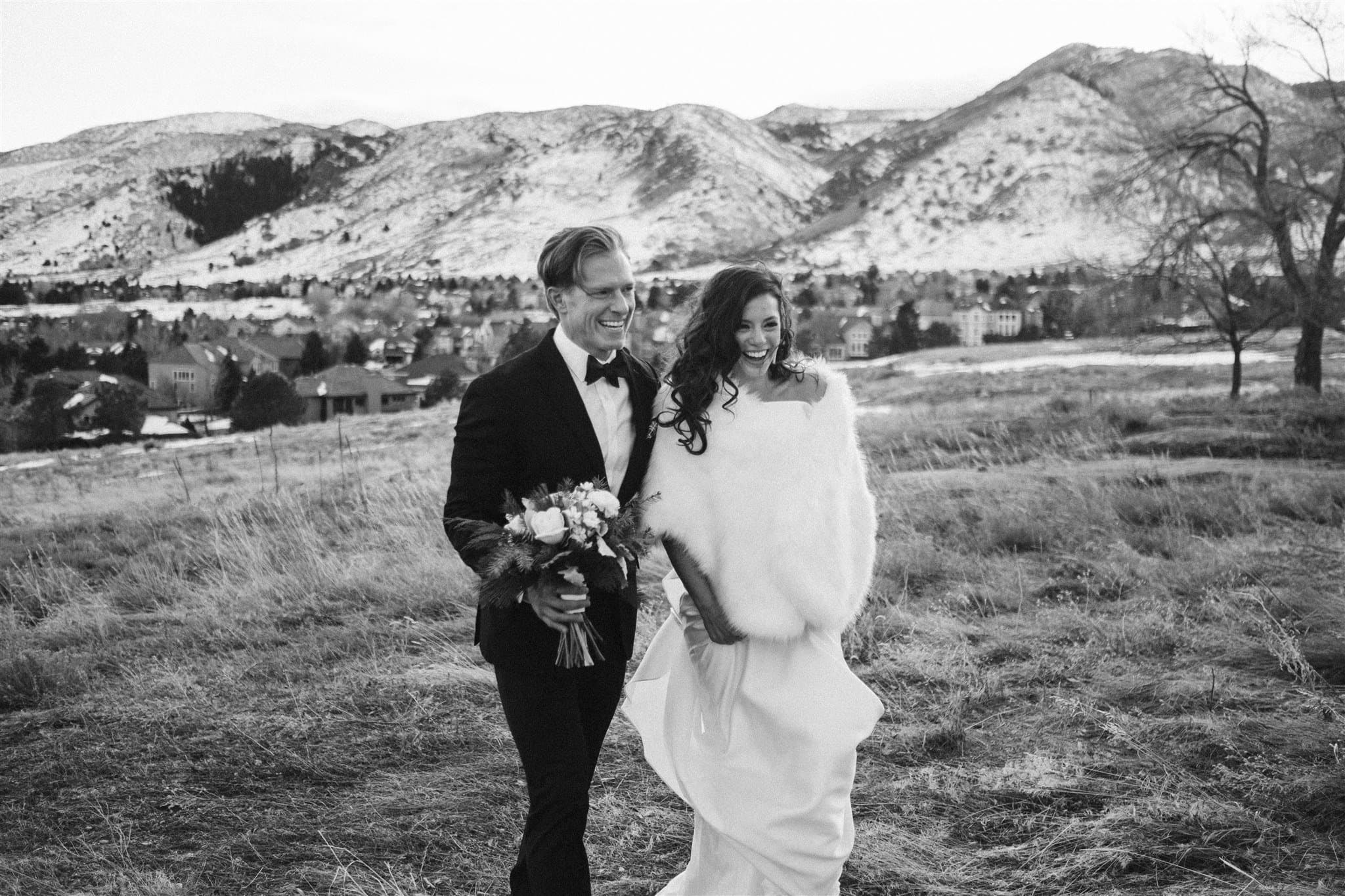 Bride and groom walking in the foothills near Denver
