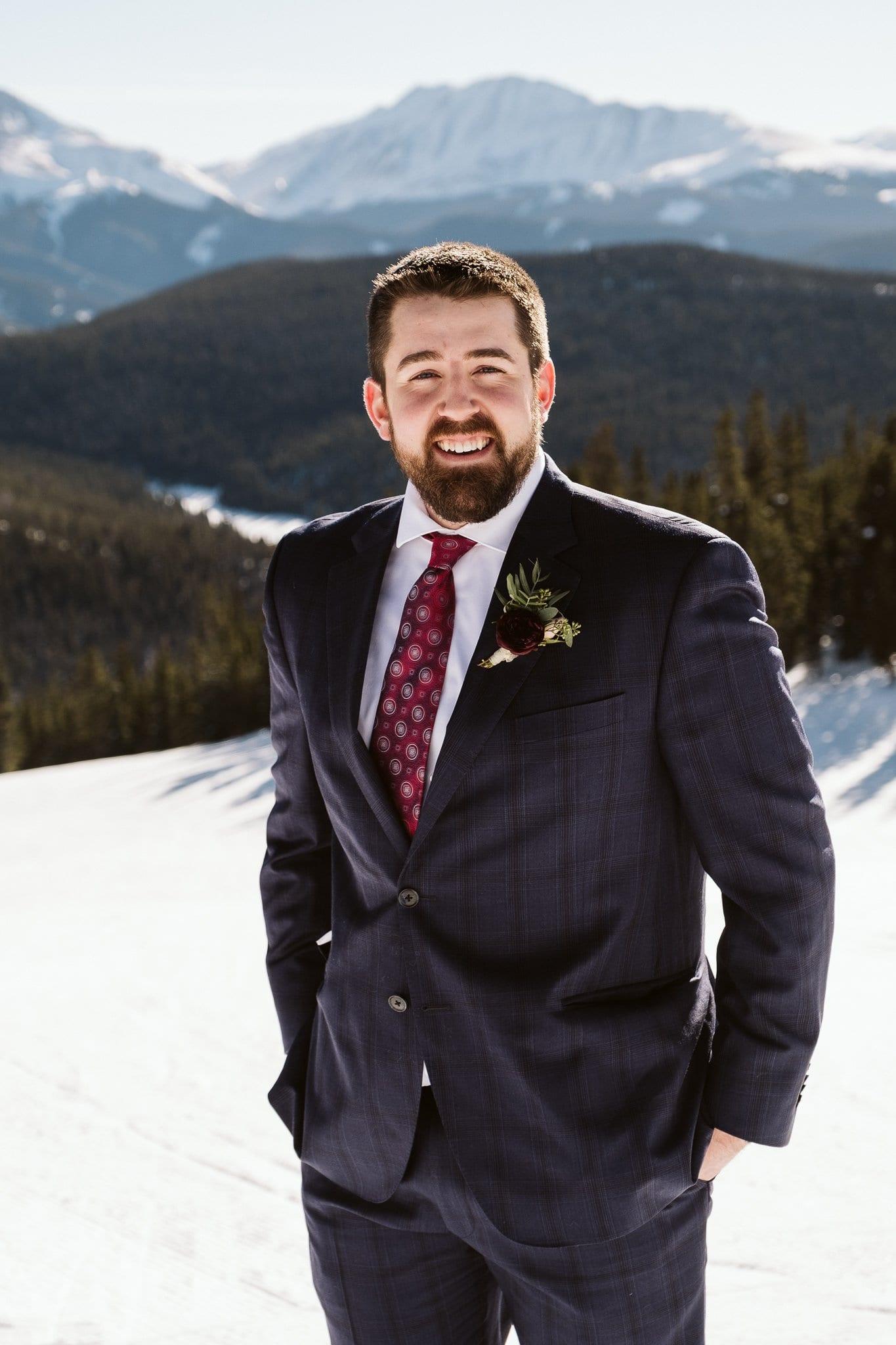 Groom wearing dark blue suit at winter elopement in Colorado.