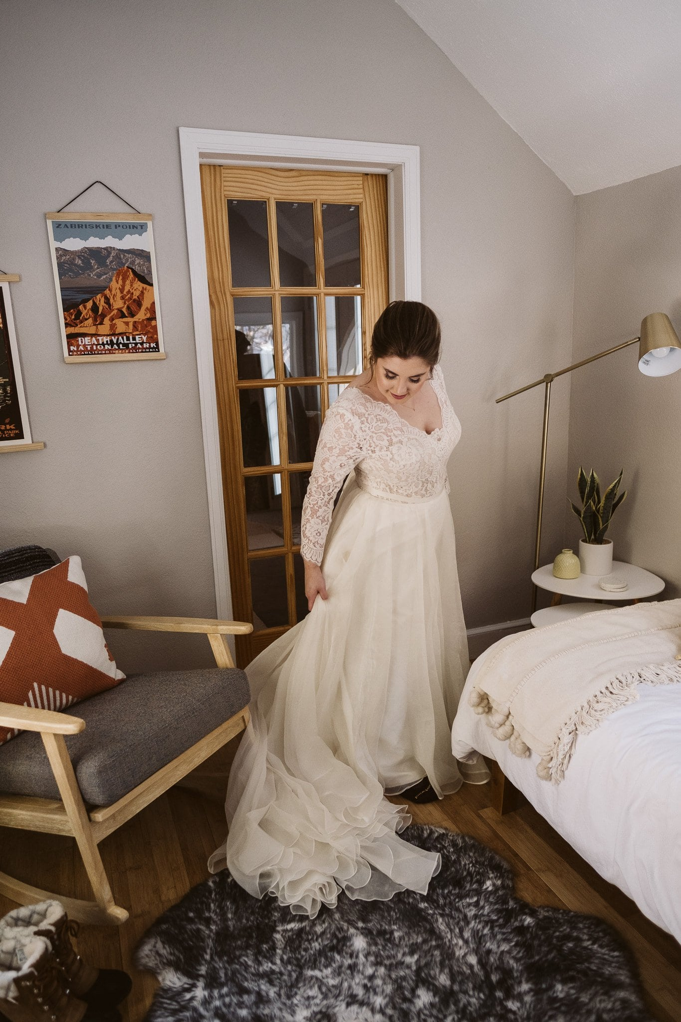 Bride getting ready for elopement in an A-Frame cabin in Breckenridge.