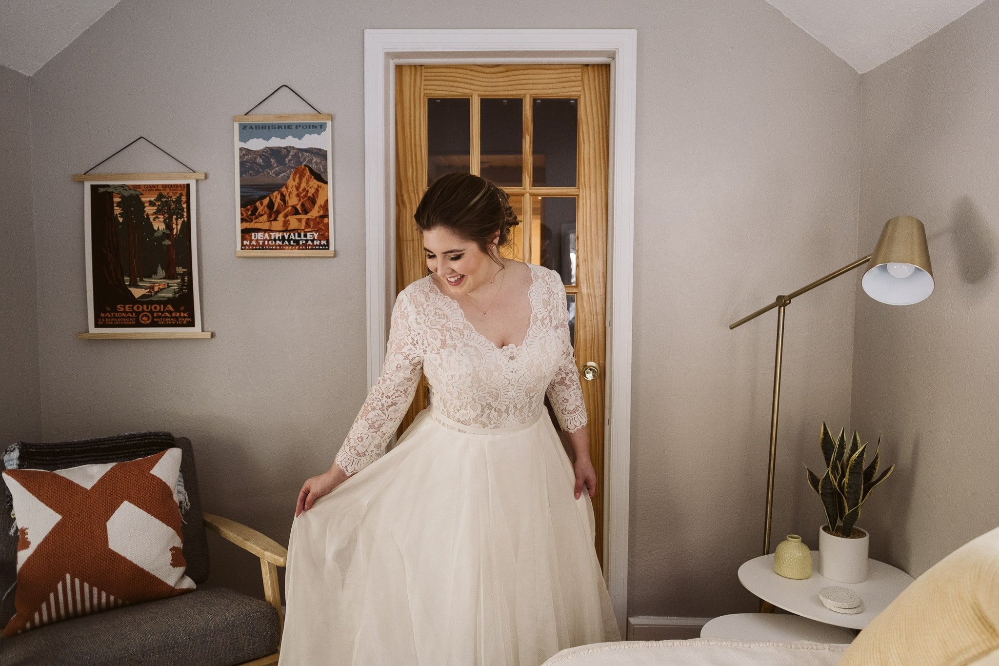 Bride getting ready for elopement in an A-Frame cabin in Breckenridge. AirBnB wedding venue.