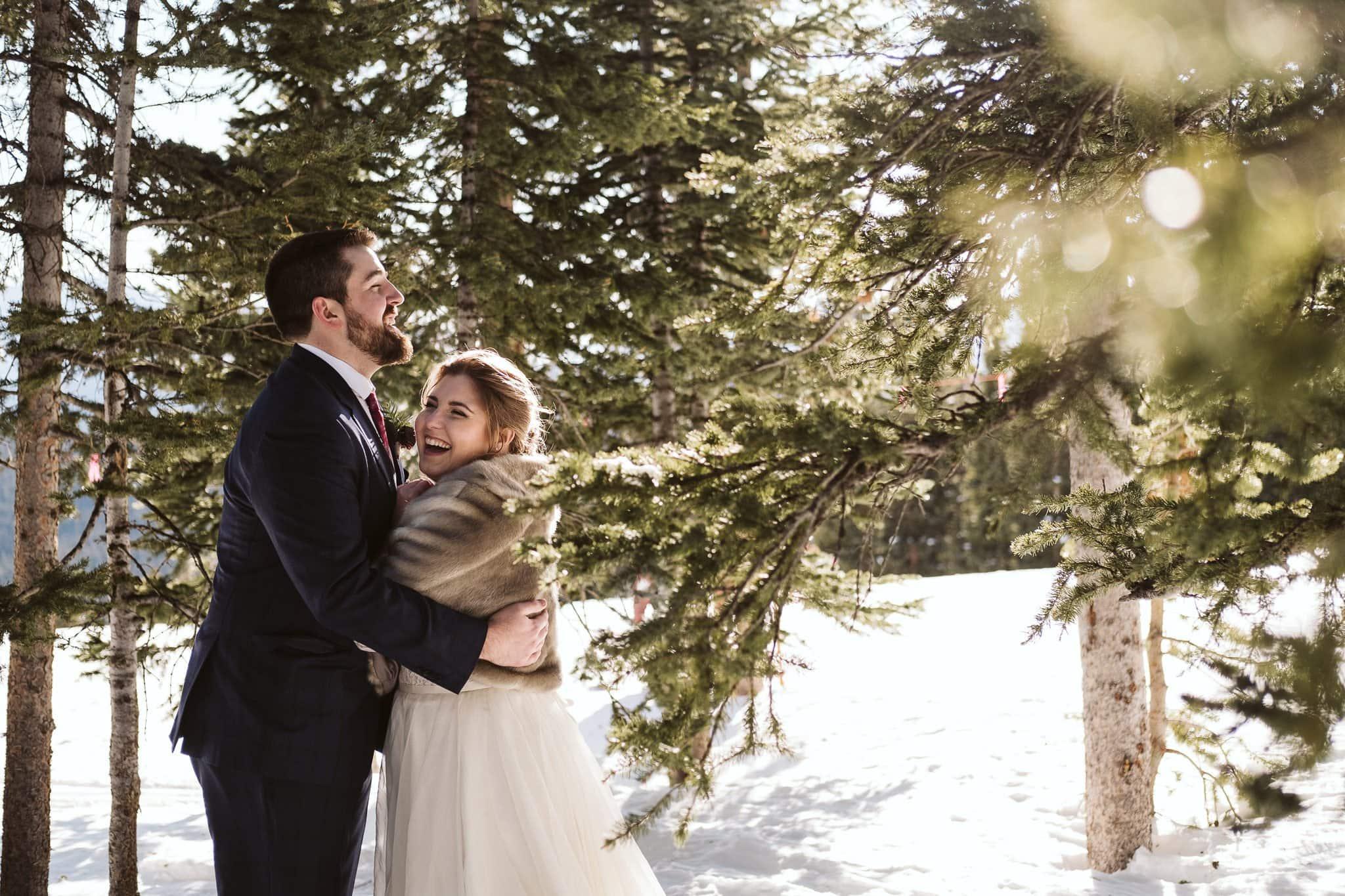 Colorado winter elopement in snowy forest.