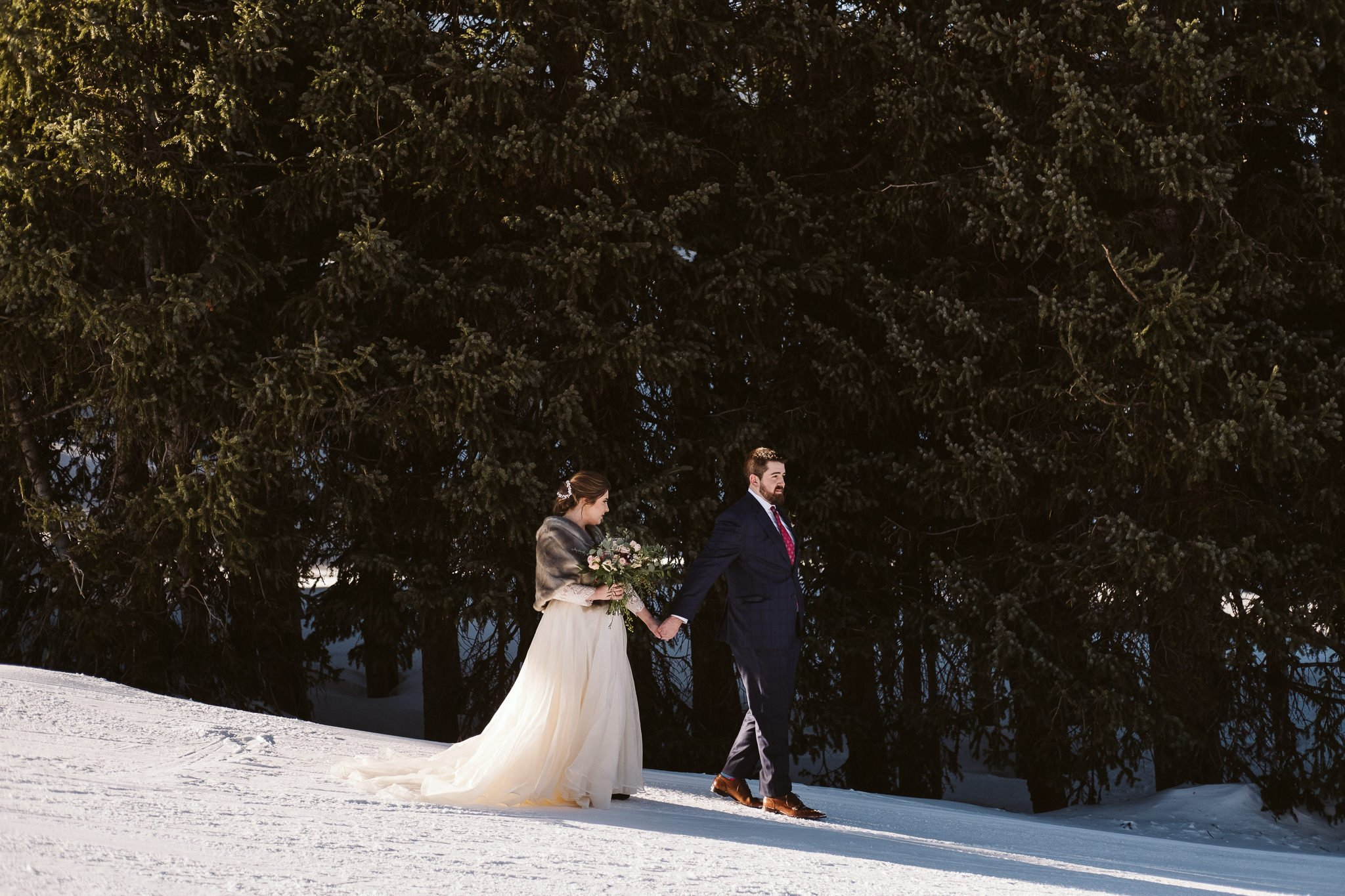 Colorado winter elopement in snowy forest.
